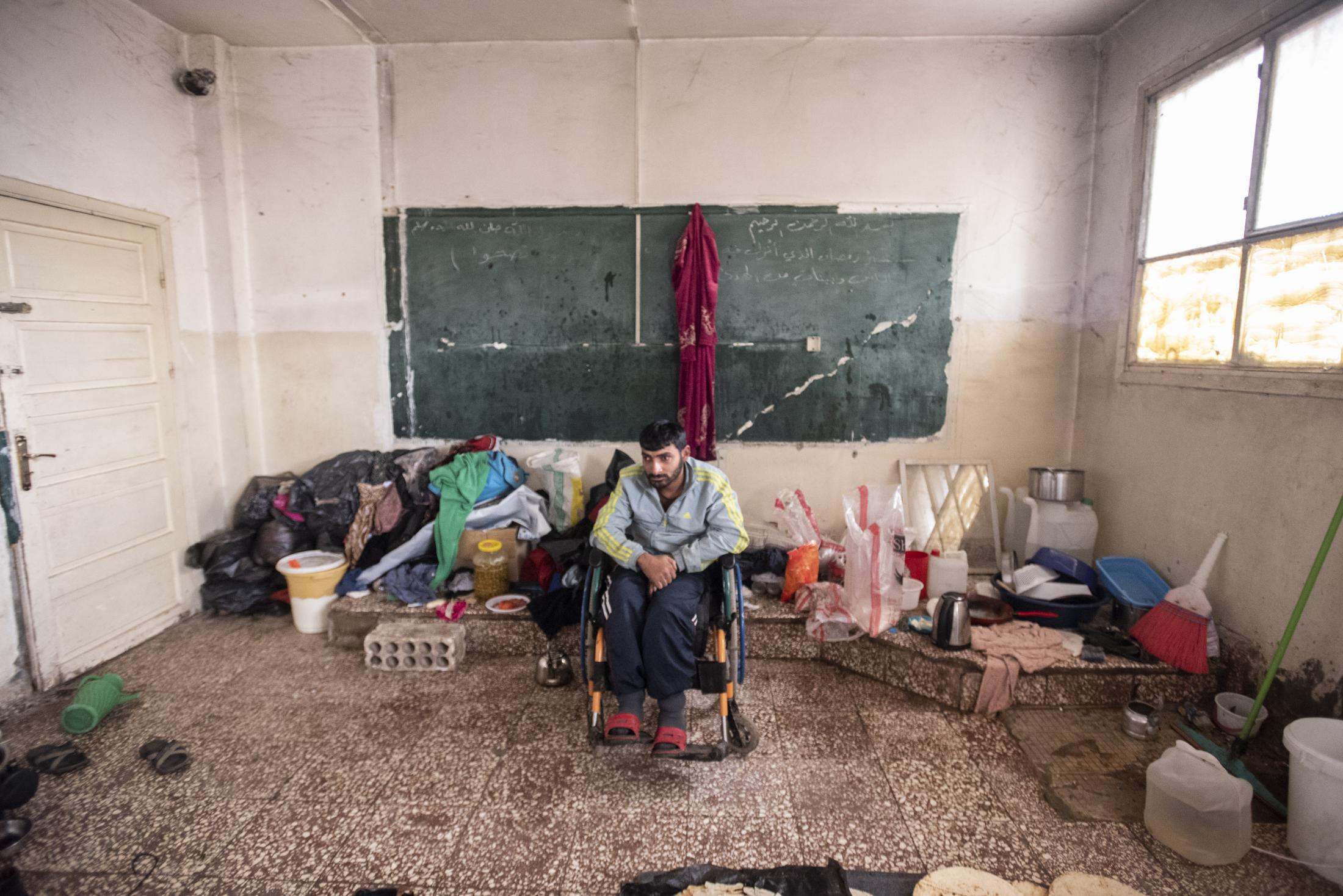 Mustafa Bakir, 25 in his room of an Amuda school who served as a refugee camp. He could only escape thanks to the help of fellow villagers in Serekaniye. He´s on a wheelchair and relies fully on his mother. After the withdrawal of US troops from northern Syria in October 2019, Turkey launched an offensive against the predominantly Kurdish areas in the northeast of the country along Islamist forces. Calls for war crimes investigations into the conduct of Ankara-backed militias are mounting ever since. (Andoni Lubaki / Euskal Fondoa)