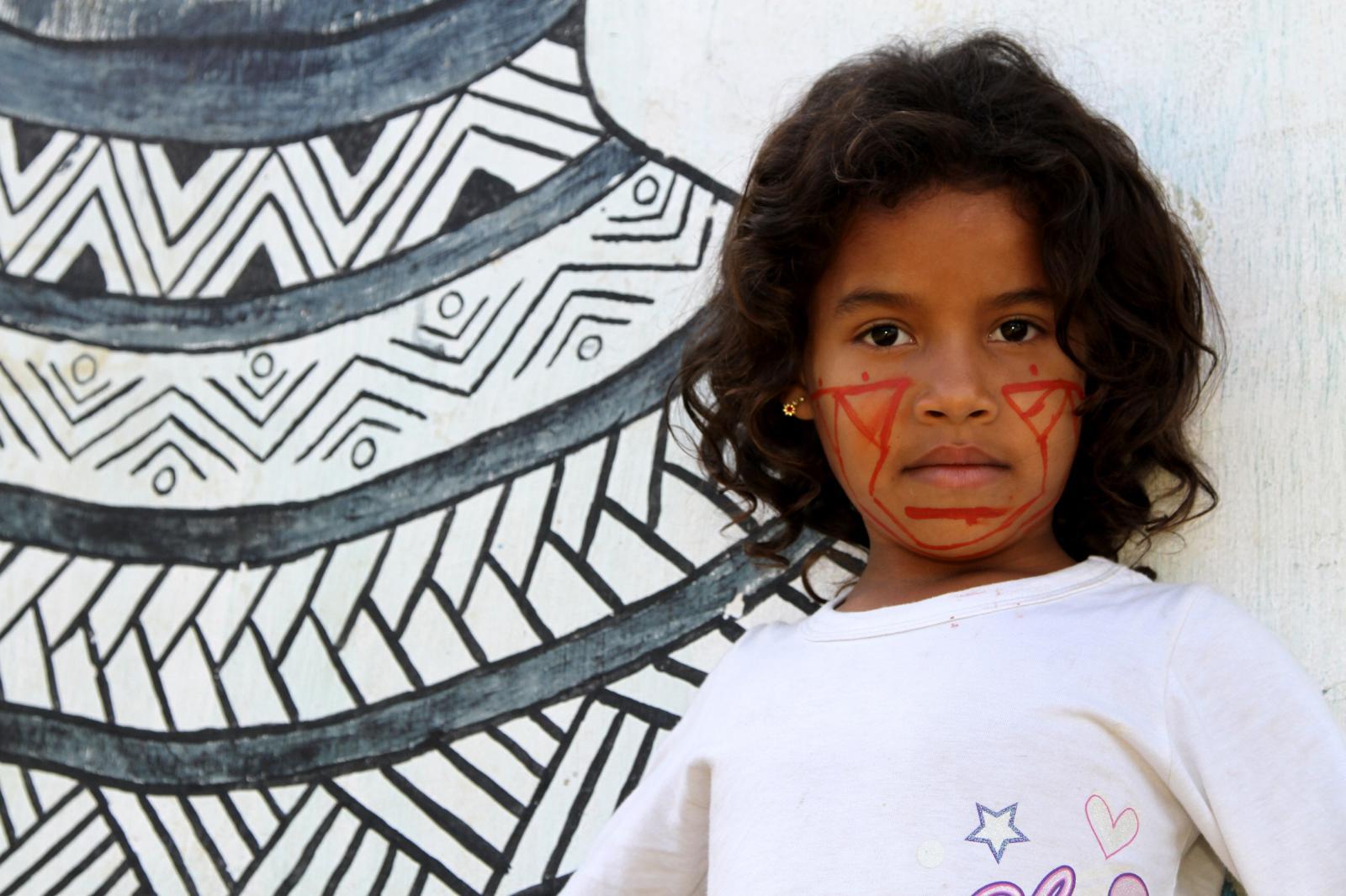 A young female Pataxó HãHãHãe photographed outside the Associação HãHãHãe e indigena de Agua Vermelha near Pau Brasil, South of Bahia estate.