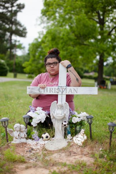 Zaira Gonzales poses for a portrait by the grave of her brother, Christian Gonzalez, in Palestine, Texas. Christian died in Falfurrias, Texas in September of 2012 while crossing illegally into the United States from Mexico. Monday, May 06, 2019 (Katie Hayes Luke for NPR )