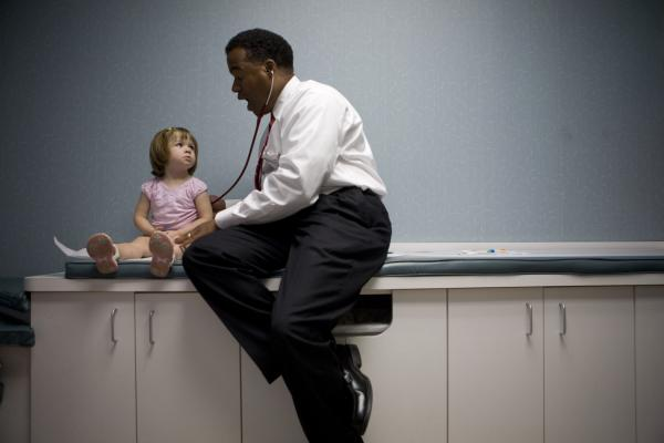 Dr. Wendell McKay examines 2-year-old Emma Churchill at his pediatric office in Howard County on June 15, 2009. He says his practice could be made more efficient through electronic record keeping.