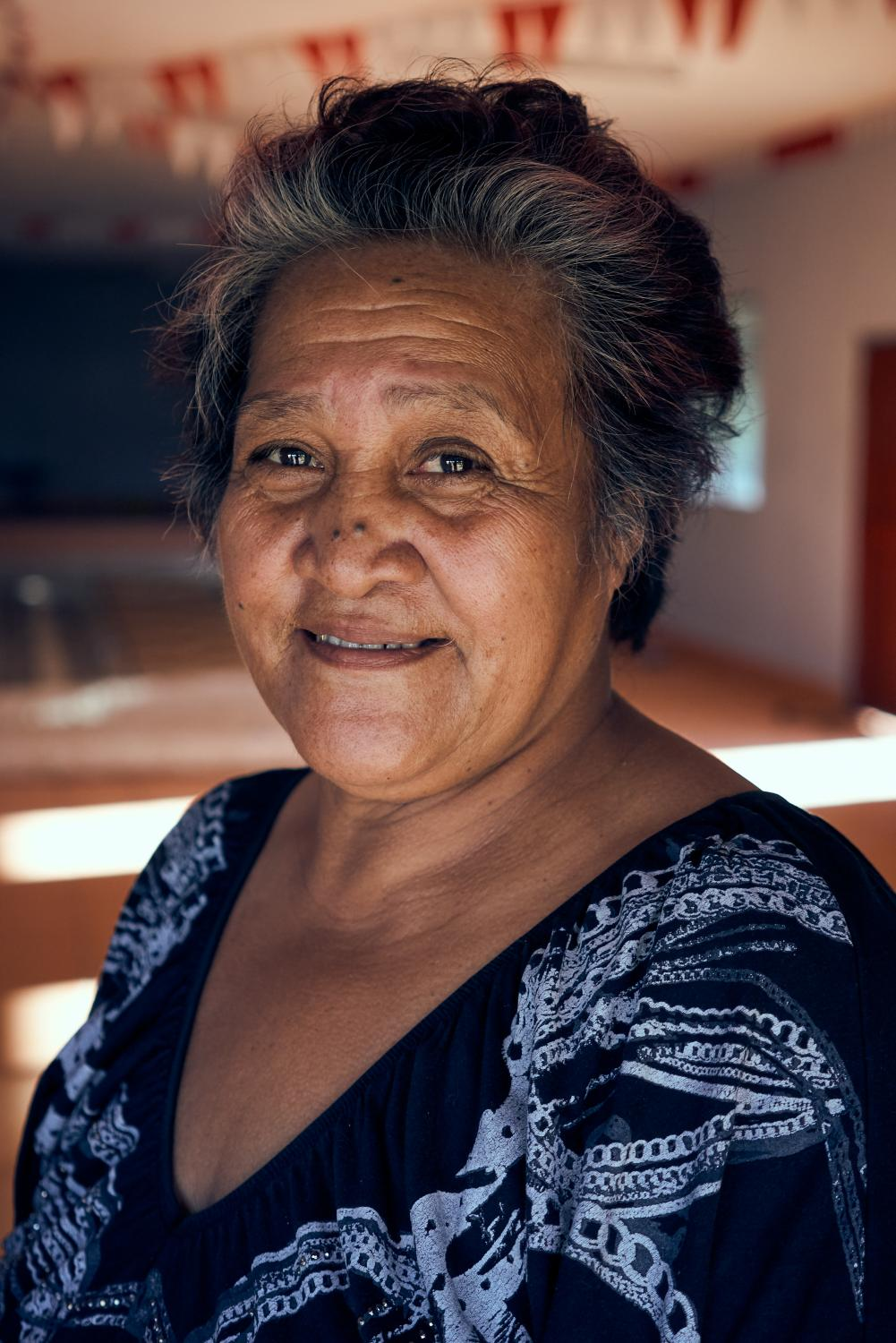 Meliame Toa Tuifua, the only female town officer in 'Eua, at the entrance of 'Angaha Community Hall.