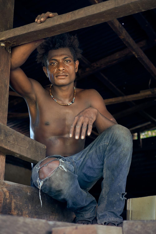 Cocoa farmer, Belton Banbansirini, age 19, at the Tupaghotua Cocoa Partnership in the Guadalcanal Plains. Tupaghotua Cocoa Plantation, Plackpost, Okea, Guadalcanal, Solomon Islands.