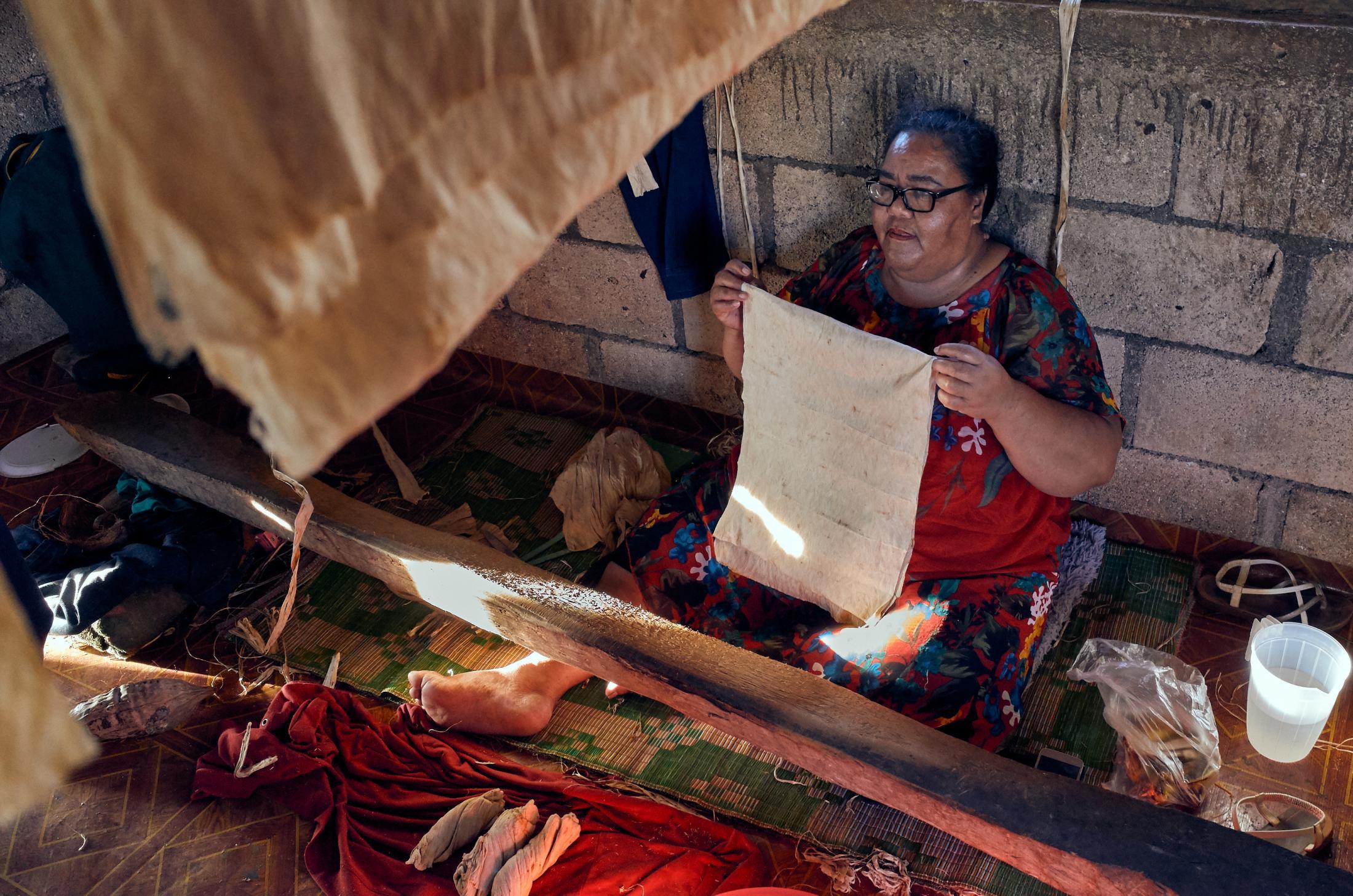 Olive Kata, age 50, makes ngatu at her home in 'Angaha, 'Eua.
