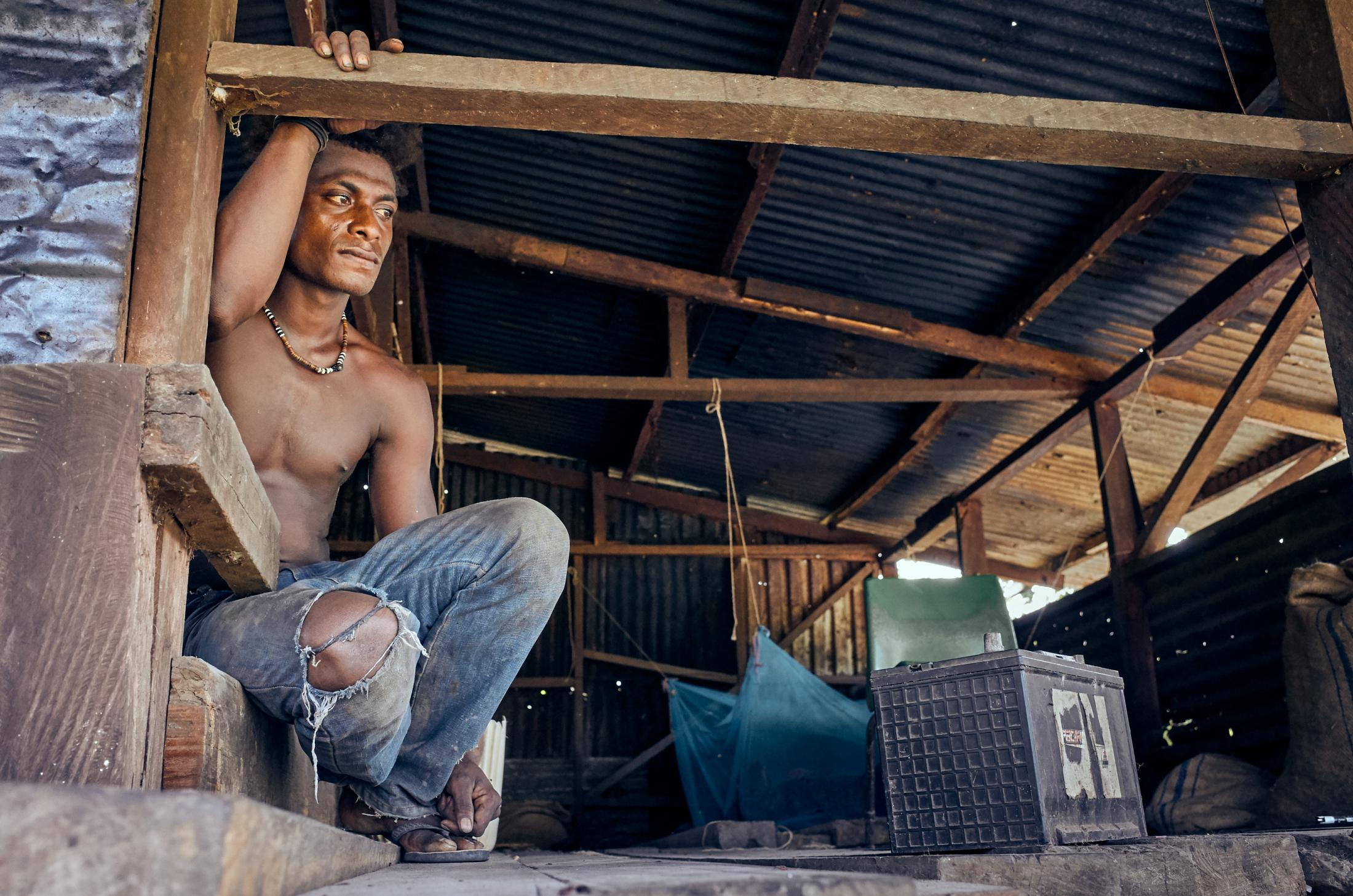 Cocoa farmer, Belton Banbansirini, age 19, at the Tupaghotua Cocoa Partnership in the Guadalcanal Plains, Solomon Islands.