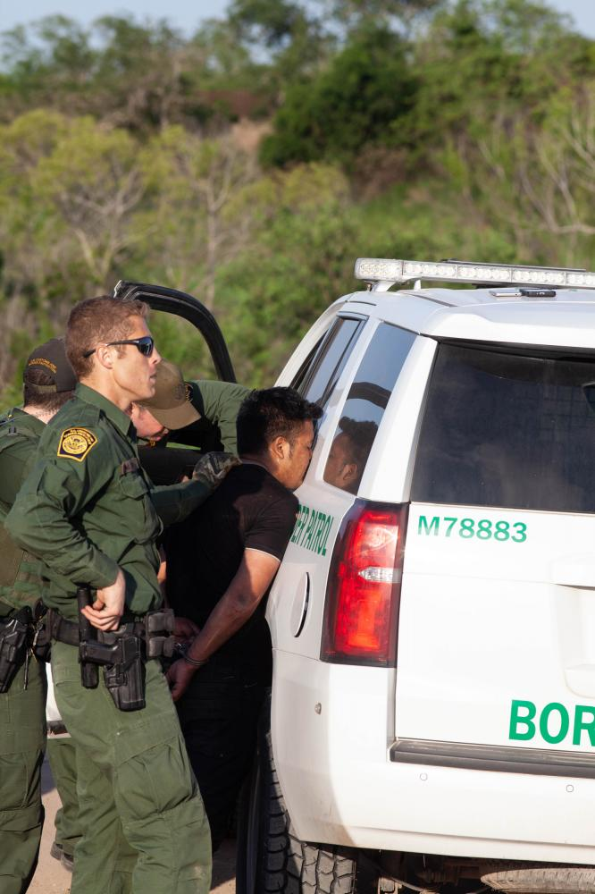 According to a border patrol agent, off the record and not photographed, they often apprehend more than 30 people - women and children- in one day. They do not have to chase them down, those seeking asylum often turn themselves in. However, the paperwork, delivering them back to be processed and taking them to medical clinics takes up most of the day.