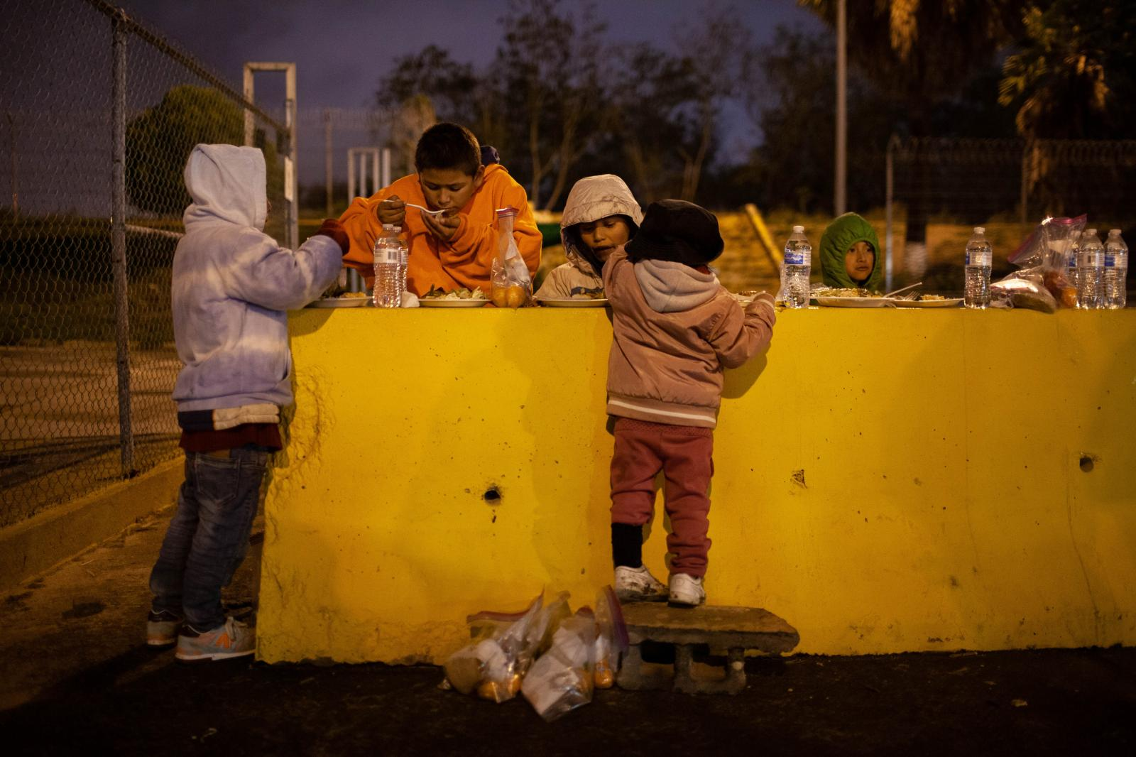 The numbers of people waiting to claim asylum swelled during the first few months of 2019. In February, Benavides would see roughly 50 people a day waiting for him. On this particular night there are over a 150 men, women and children waiting in line for dinner. Team Brownsville loaded up three wagons with seven tents, water, two large containers of rice and beans, twenty boxes of pizza, hula hoops and one size nine and a half shoes.