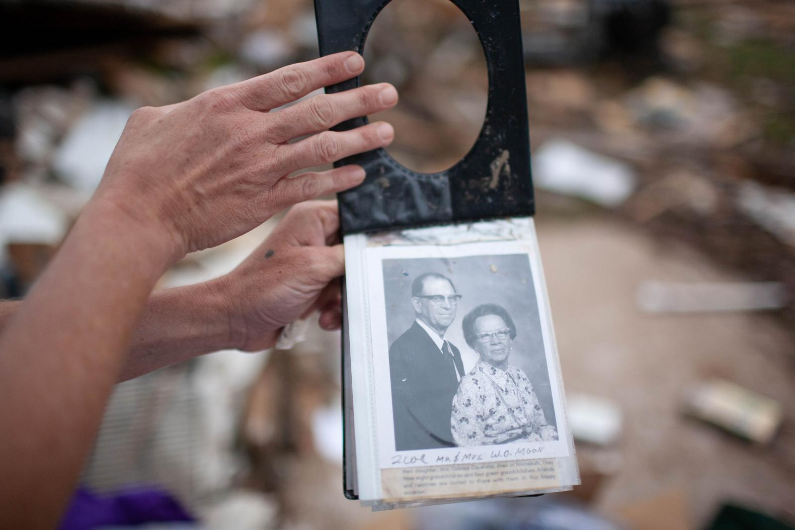 "Around 3pm when the tornado hit his community, Carter could hear the tornado approach. ""It was like a giant vacuum cleaner going over you."" Amongst the rubble, Bree Owens found pictures of her great- grandparents."