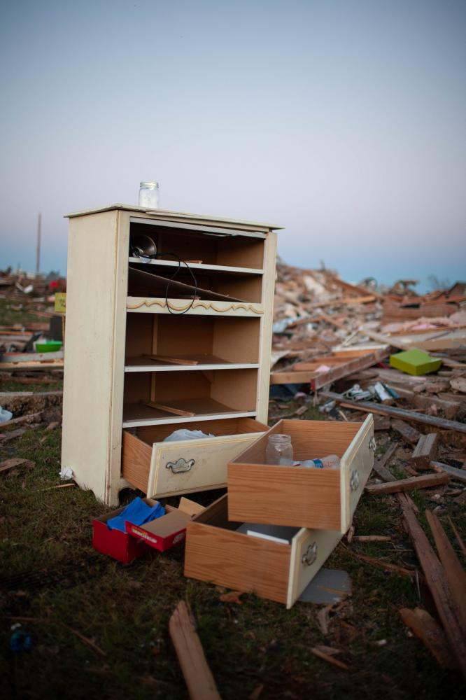 The Trillo home is one of the few homes in the division that is still standing, though everything inside is damaged and many belongings, such as this dresser, were scattered into the yard. Sylvia was amazed at the outpouring of help the community received from strangers following the tornado on Monday, May 20, 2013.