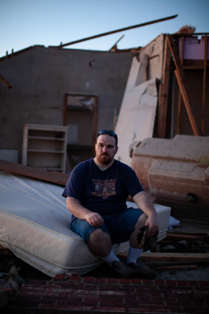 Matt Claxton, a chef at the Hospital in Midwest City, poses for a portrait at his home in the Heatherwood Addition, a subdivision in Moore located a mile and a half east of I35 in Moore, Ok Wednesday, May22, 2013. Matt Claxton, his wife (not pictured), and their two dogs took shelter in a neighbor's storm shelter across the street. The area behind Claxton is the room that they were planning on taking shelter in for the tornado.