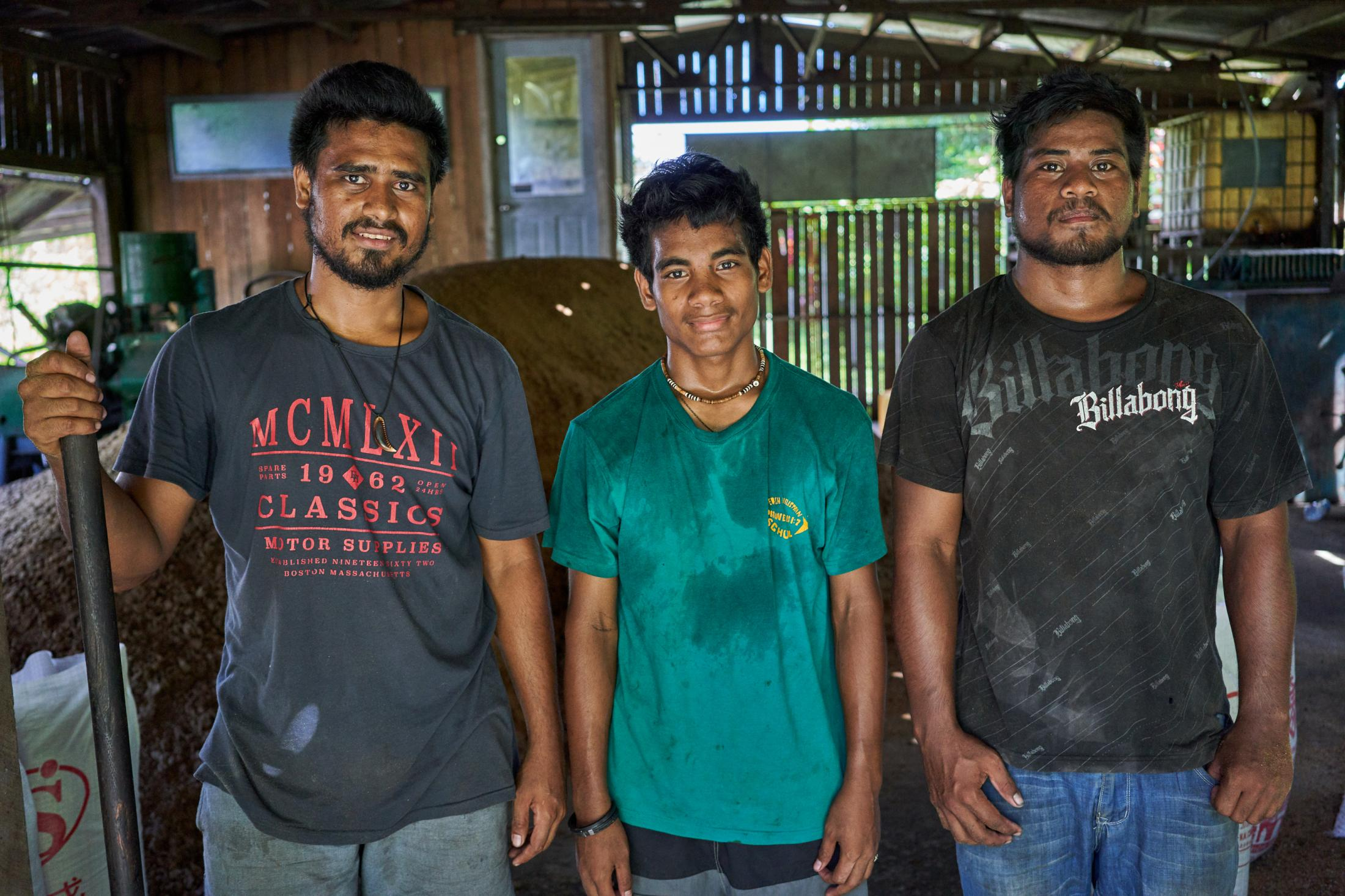 Jack Chottu (grandson of the founder of Chottu's Guadalcanal Products, left), age 23, Jonathan Atanikakia, age 21 (middle), and John Atanikakia, age 15 (right), in one of the workshops in the Chottu facility.