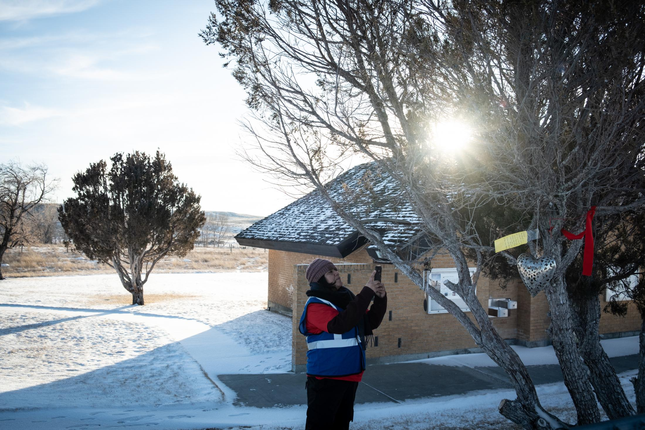 A member of the Northern Cheyenne rescue team photographing a gift brought in by neighbors.