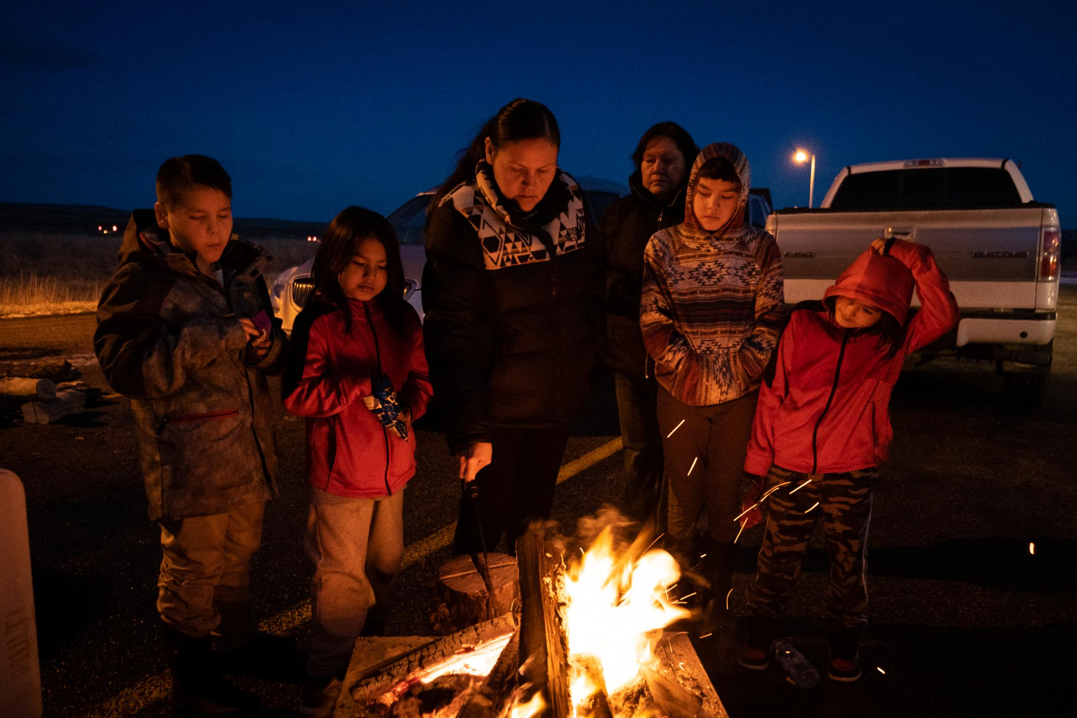 Selena's cousins gathered near a fire at the rest stop on the 10th night of her disappearance.