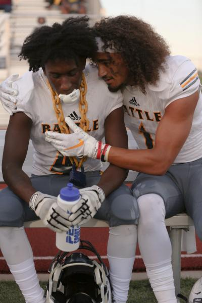 Battle senior corner back and strong safety Quentarius Vaughn(left) wears the lockdown chain while senior corner back and running back Trevonne Hicks(right) congratulates him at Smith-Cotton High School in Sedalia on Friday sept. 6, 2019. Quentarius was given the lockdown chain after getting an interception and scoring a touchdown on the same play.