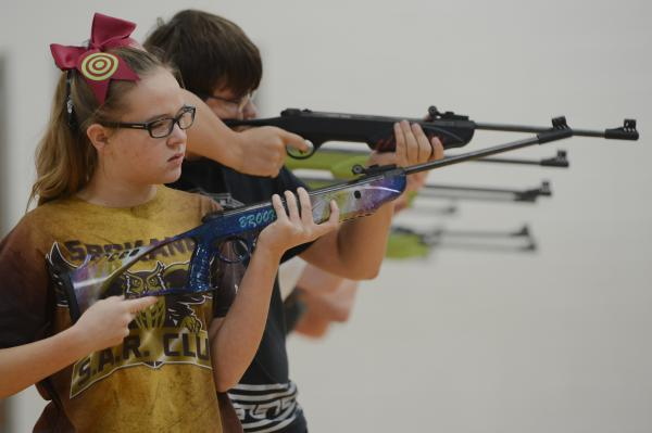 Brooklyn Grant, 13, from Spokane, Missouri looks downrange at the Student Air Rifle Program Tournament at Clever High School on November 14, 2019. Brooklyn took first place in the middle school individuals girls category.