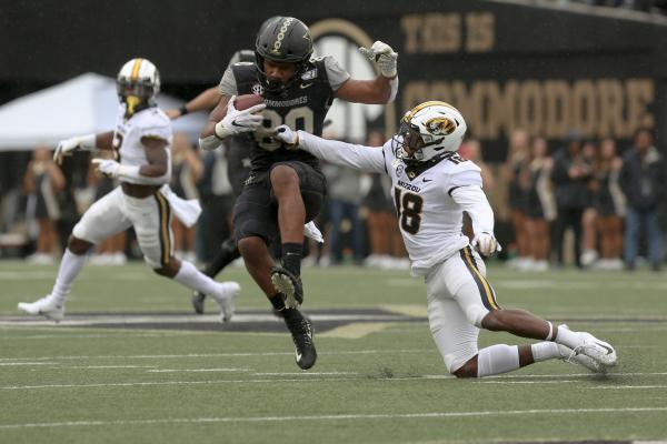 A Vanderbilt player dodges a tackle attempt by a Missouri player at Vanderbilt Stadium in Nashville, TN on Saturday, October 19, 2019.