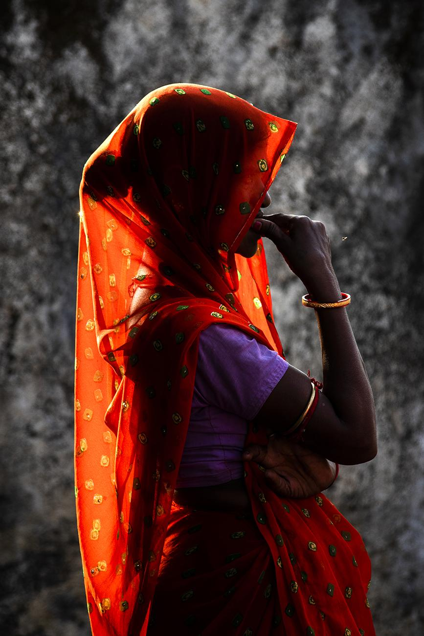 Woman covering her head and face because she is outside. Indore, India. (Wednesday.Nov,6.2019)