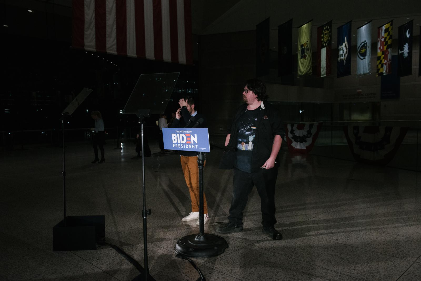 Campaign workers for former Vice President Joe Biden prepare the stage for Biden to speak at the National Constitution Center in Philadelphia, PA on Tuesday, March 10, 2020. Biden and Senator Bernie Sanders both cancelled their Cleveland, Ohio rallies because of concerns about the coronavirus. Hannah Yoon NYTPRIMARY