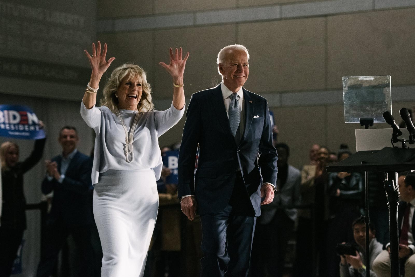 Former Vice President Joseph R. Biden Jr., right, walks in with his wife, Jill Biden, at the National Constitution Center in Philadelphia, PA on Tuesday, March 10, 2020. Biden and Senator Bernie Sanders both cancelled their Cleveland, Ohio rallies because of concerns about the coronavirus. Hannah Yoon NYTPRIMARY
