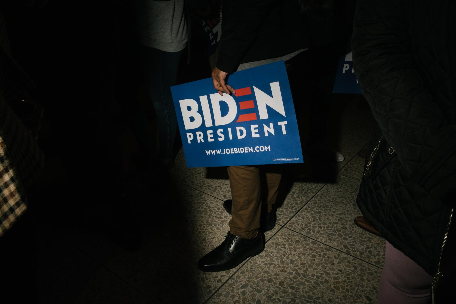 A supporter holds a sign to support former Vice President Joseph R. Biden Jr. after he spoke at the National Constitution Center in Philadelphia, PA on Tuesday, March 10, 2020. Biden and Senator Bernie Sanders both cancelled their Cleveland, Ohio rallies because of concerns about the coronavirus. Hannah Yoon NYTPRIMARY