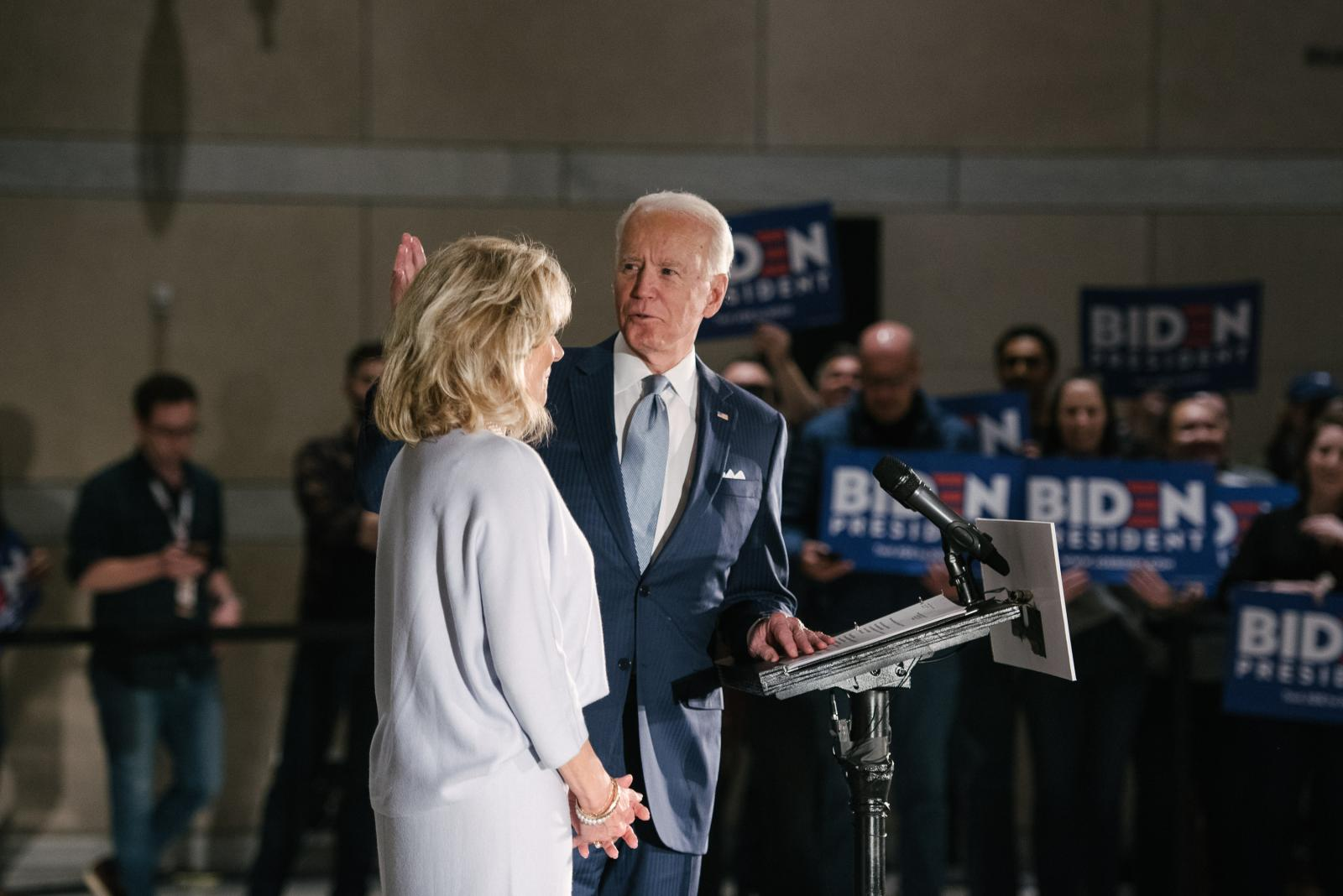 Former Vice President Joseph R. Biden Jr., right, waves to his staff and supporters, with his wife Jill Biden, by his side at the National Constitution Center in Philadelphia, PA on Tuesday, March 10, 2020. Biden and Senator Bernie Sanders both cancelled their Cleveland, Ohio rallies because of concerns about the coronavirus. Hannah Yoon NYTPRIMARY