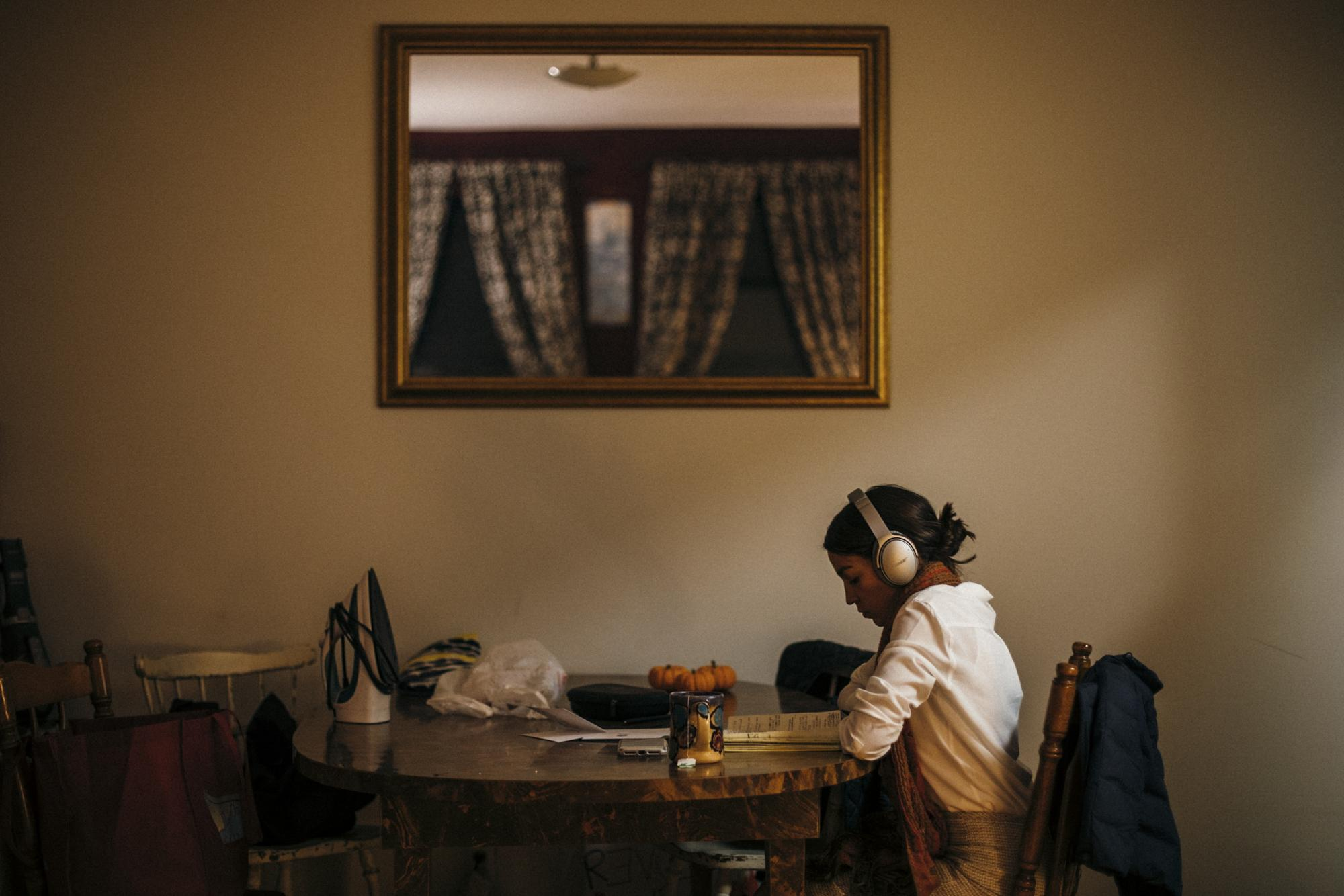As the polls close and the waning moments NY-14 General Election begin to unfold, hopeful congressional candidate Alexandria Ocasio-Cortez takes a moment to decompress as she writes a concession speech and victory speech as her mother, Blanca, irons her dress beside her, in the Sunnyside neighborhood of Queens, New York, November 6, 2018.