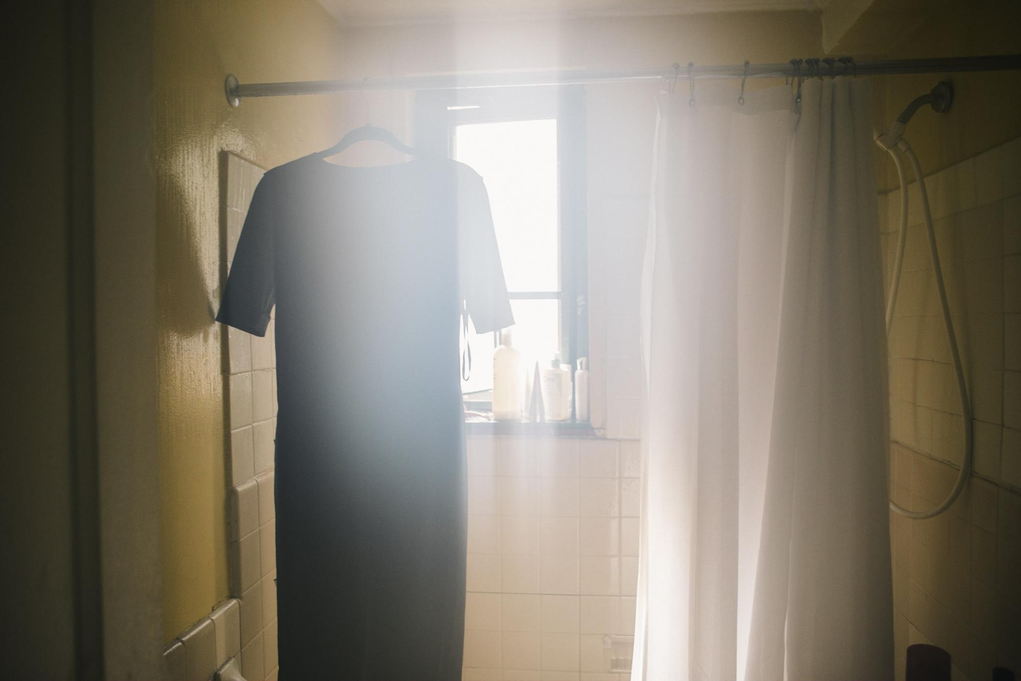 The early morning sun peers through the window as Alexandria steams one of her dresses in her bathroom before starting a day full of interviews, in the Parkchester neighborhood of The Bronx, New York, May 11, 2018.