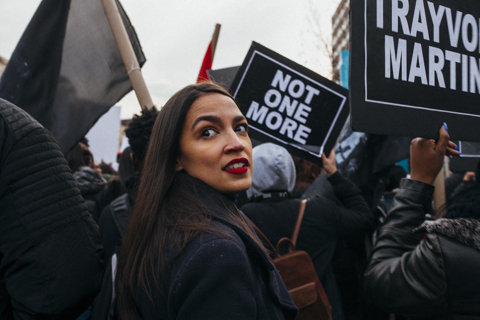Amongst chanting and song, Alexandria Ocasio-Cortez joins the crowd of demonstrators being led by Black Lives Matter Greater New York Youth Coalition down Malcolm X Blvd, in the Harlem neighborhood of Manhattan, New York, December 2, 2017.