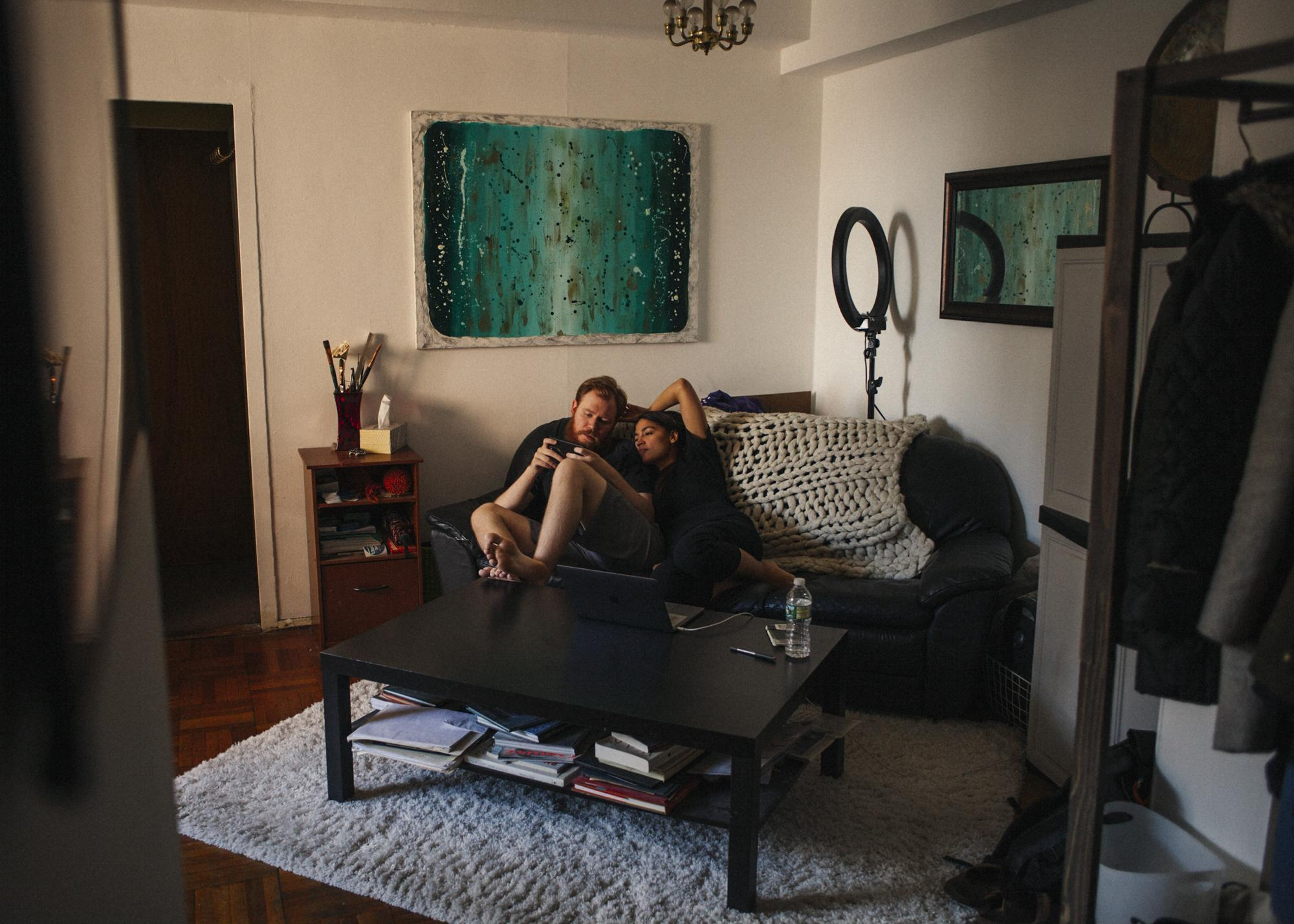 In a rare moment of downtime, Alexandria takes advantage of the opportunity to spend time with her boyfriend Riley Roberts at their Parkchester apartment, in The Bronx borough of New York City, April 8, 2018.