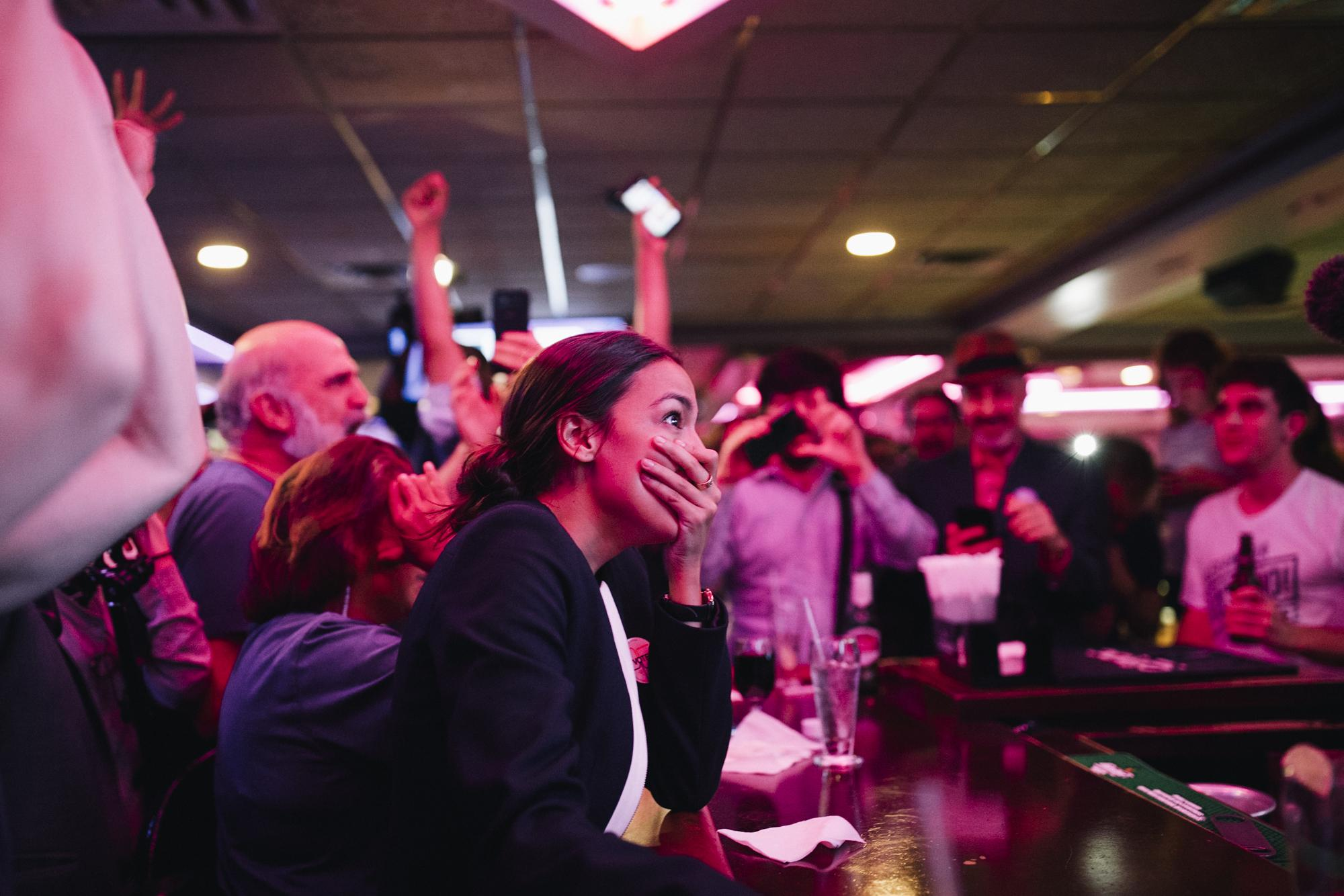 Roars erupt into the air at the Park Billiards Cafe and Sports Bar as congressional candidate Alexandria Ocasio-Cortez officially won the NY-14 primary against incumbent and Democratic party heavyweight, Joseph Crowley, in The Bronx borough of New York City, June 26, 2018.