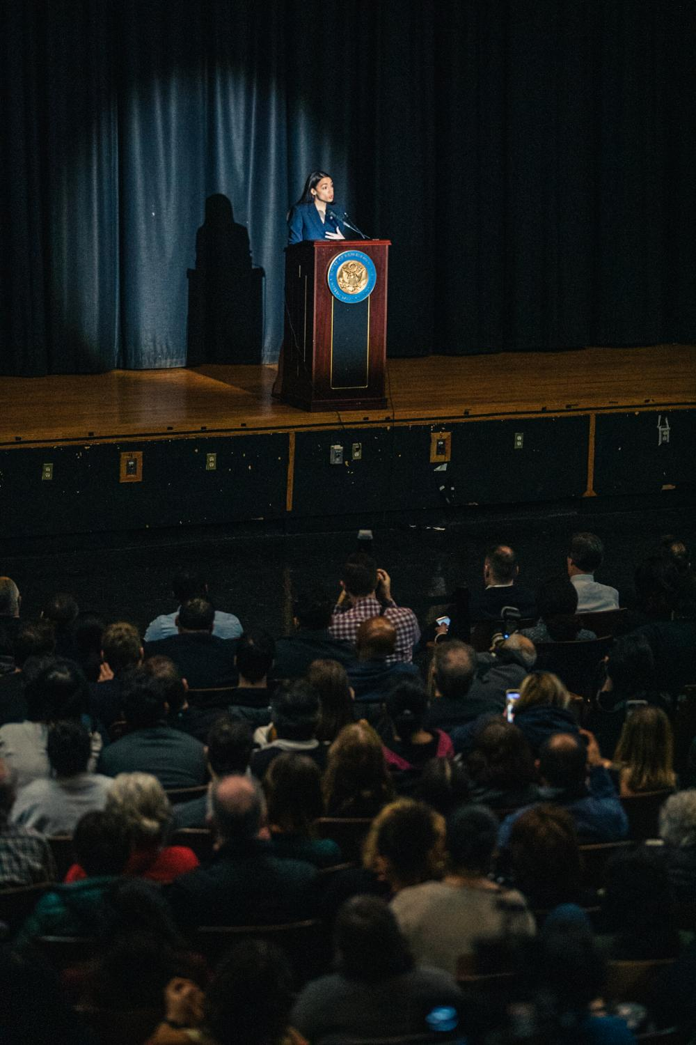 """""""A-O-C"""" chants erupt into the air of the Renaissance School for Musical Theater and Technology as Congresswoman Alexandria Ocasio-Cortez speaks to constituents about her agenda in office during her formal inaugural address at the Renaissance School for Musical Theater and Technology, in the Bronx borough of New York City, February 16, 2019."""