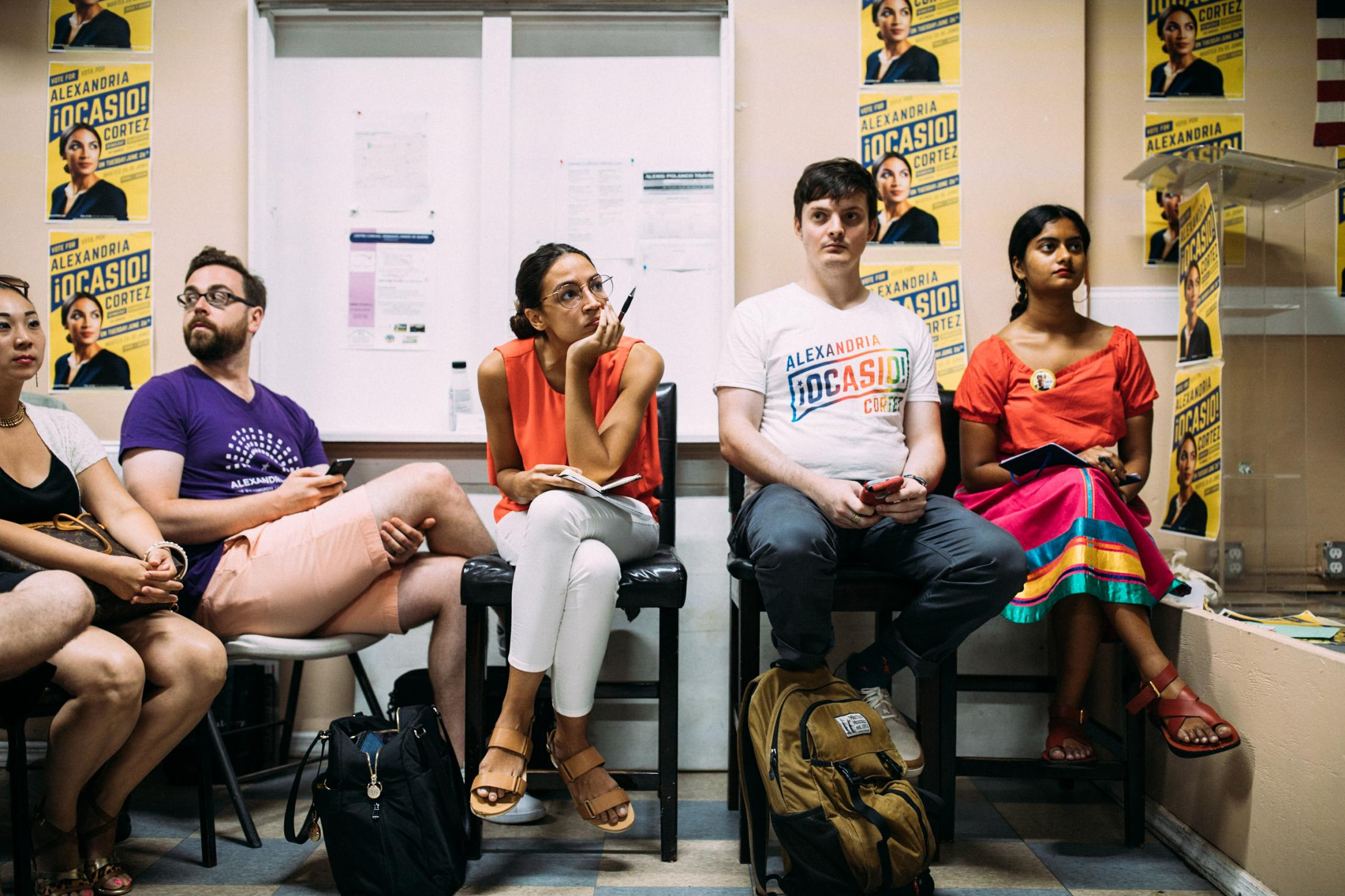 Congressional candidate Alexandria Ocasio-Cortez sits and listens to the concerns of her Queens constituents at a town hall forum in Corona, in the Queens borough of New York City, August 12, 2018.