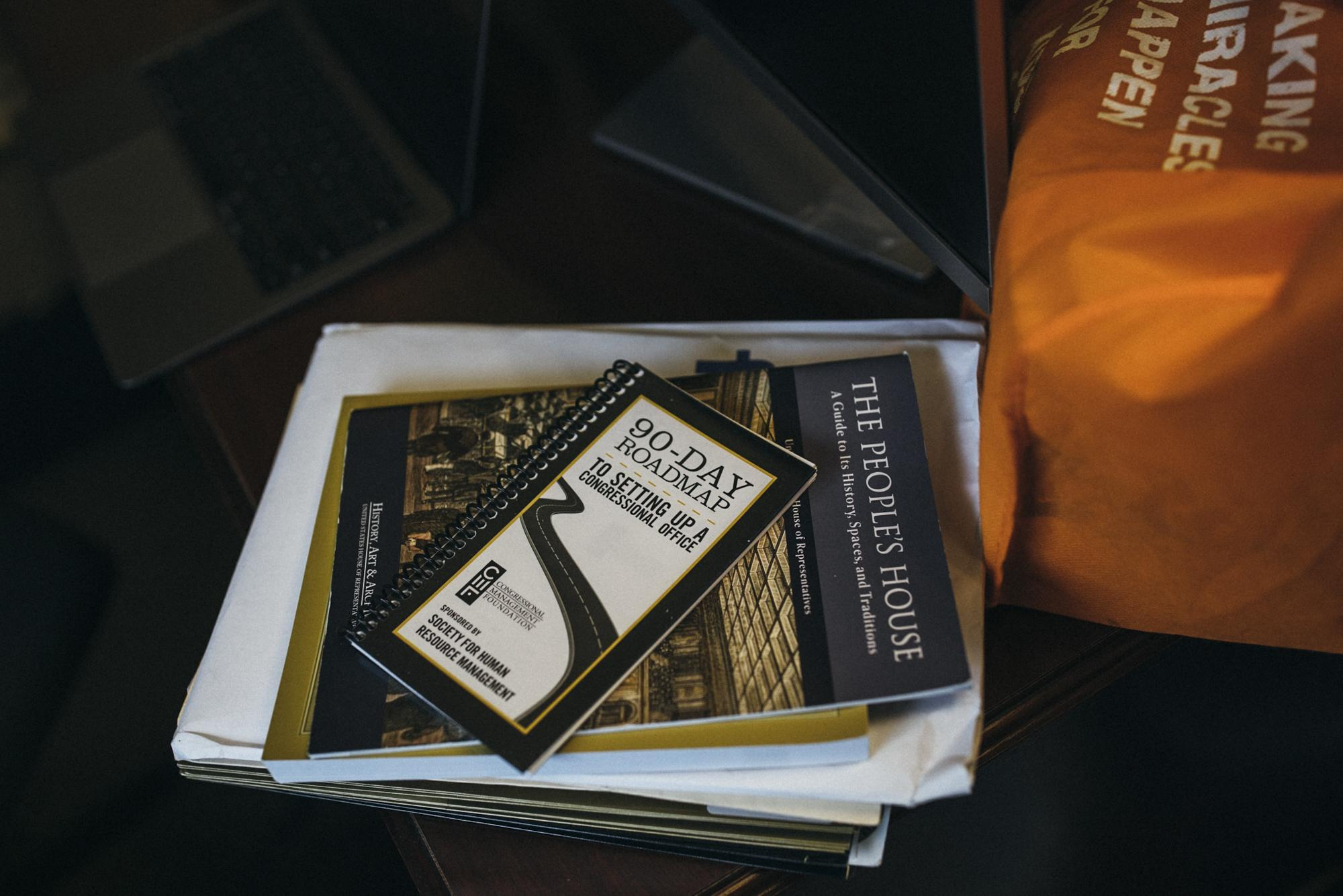 """A book whose title reads """"90-Day Roadmap"""" sits on top of a desk in the office of Congresswoman Alexandria Ocasio-Cortez in the Cannon House Office Building, in Washington D.C. District of Columbia, United States of America, January 2, 2019."""