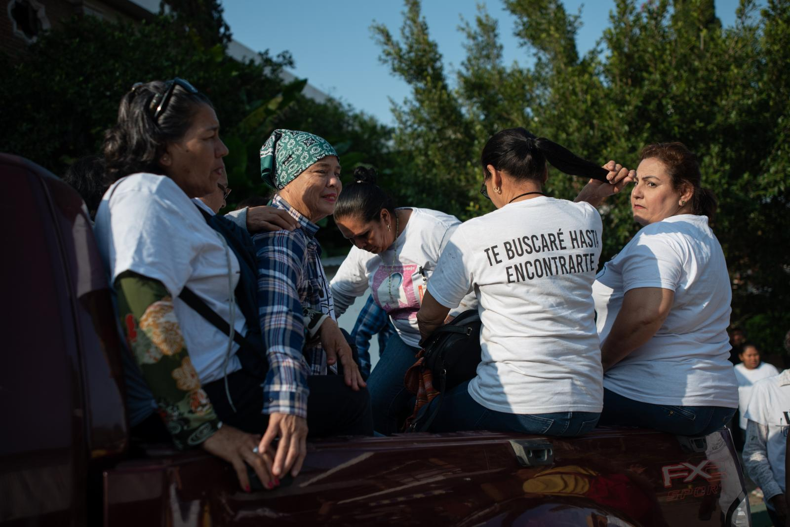 "The seekers collective ""Las Rastreadoras del Fuerte"" from Sinaloa, Mexico, board a pickup truck inside the Casa de la Iglesia center, where they housed about 300 people associated with social groups who participated in the fifth National Missing Persons Search Brigade, on February 20, 2020 in Papantla, Veracruz, Mexico, on February 20, 2020. Victoria Razo for NPR"