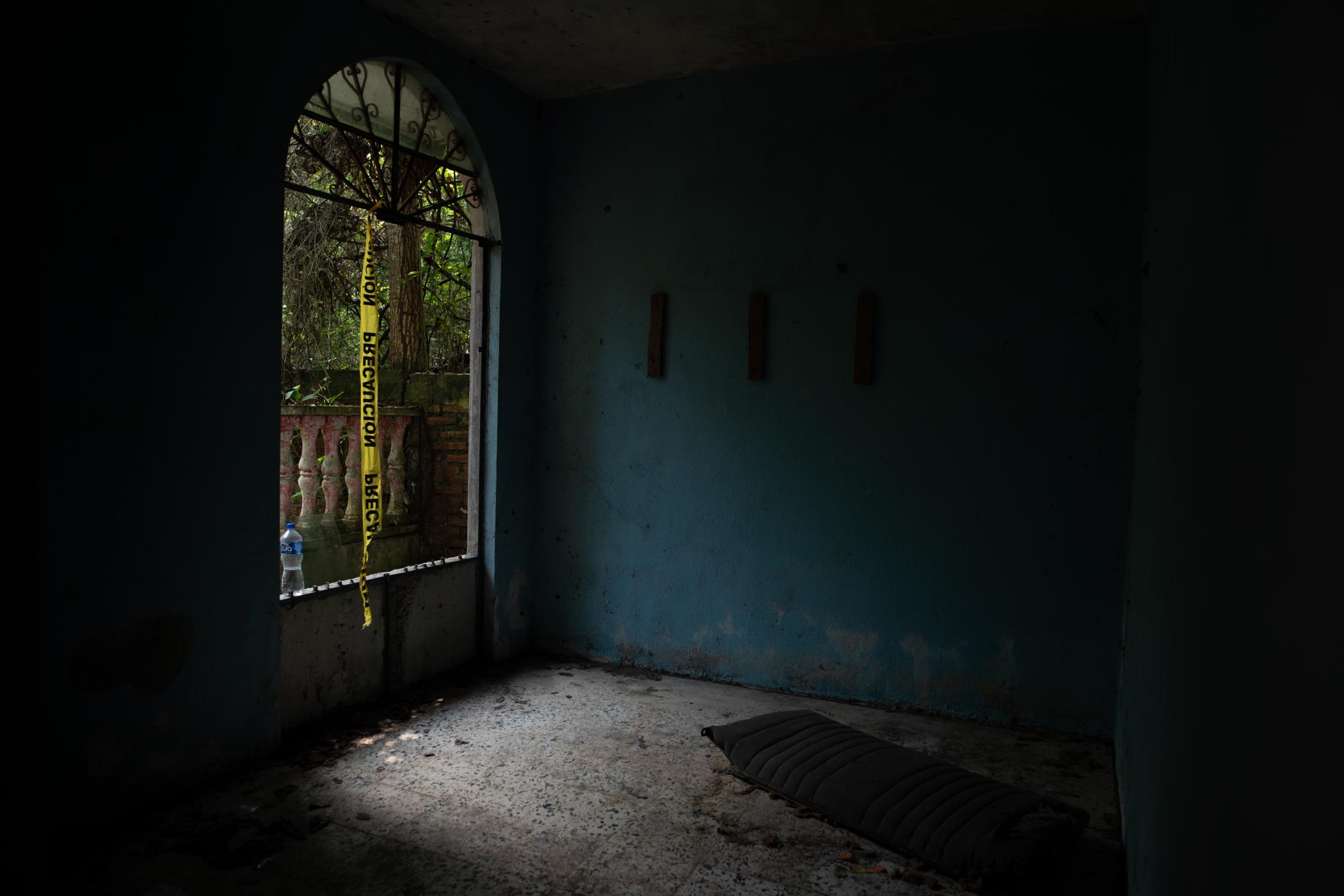 """Interior view of the house located in the ranch """"La Gallera"""" where human remains have been located during the fifth National Missing Persons Search Brigade in Tihuatlán, Veracruz, Mexico, on February 20, 2020. Victoria Razo for NPR"""