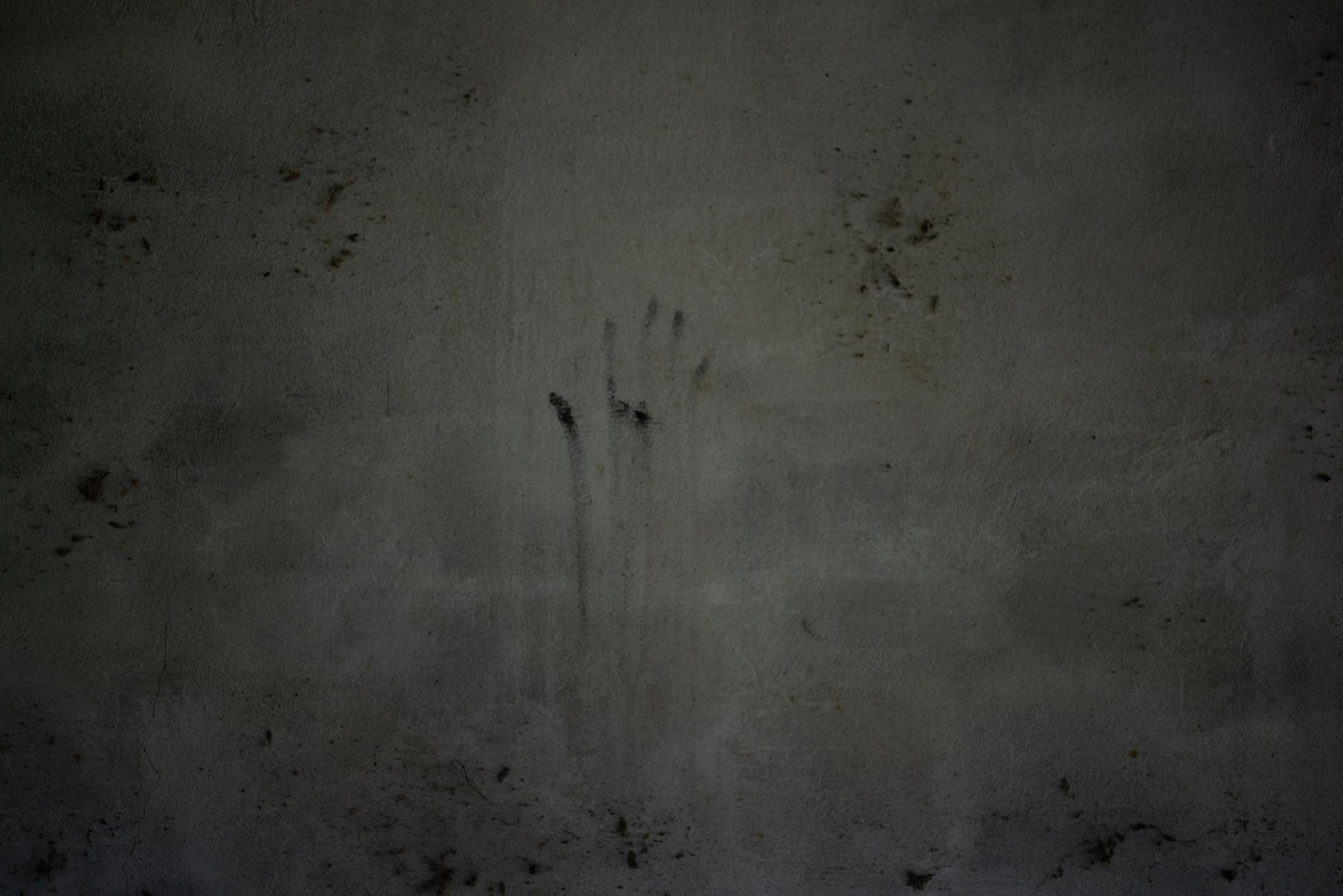 """The handprint made of ashes inside the house located in the ranch """"La Gallera"""" where human remains have been located during the fifth National Missing Persons Search Brigade in Tihuatlán, Veracruz, Mexico, on February 20, 2020. Victoria Razo for NPR"""