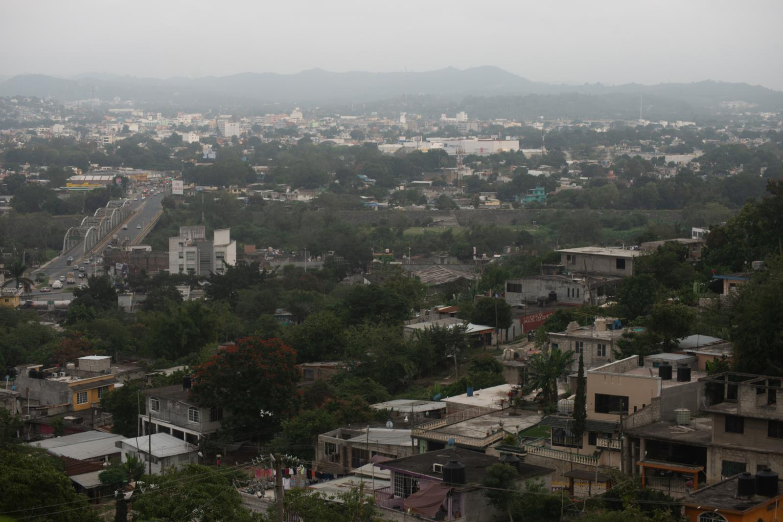 View of a neighborhood near the field that is investigated by police authorities and family groups participating in the fifth National Missing Persons Search Brigade in Tihuatlan, Veracruz, Mexico, on February 20, 2020. Victoria Razo for NPR