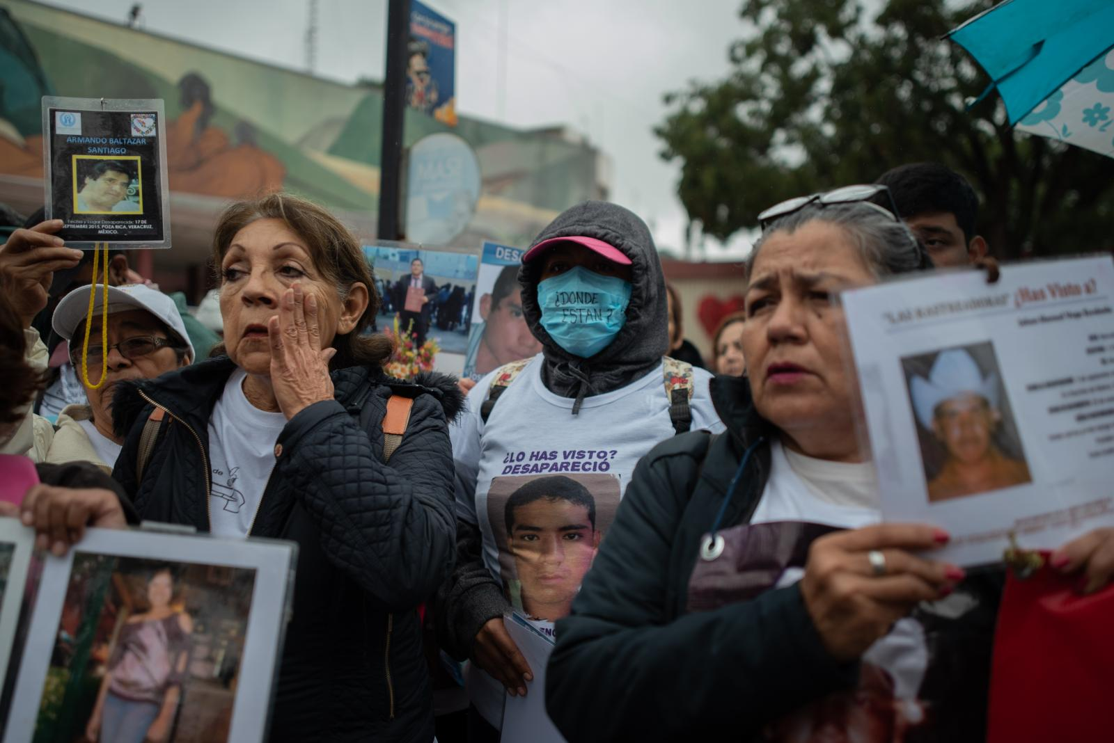 A group of women show portraits of their relatives during a demonstration of missing persons. Approximately 300 people participated in the fifth National Missing Persons Search Brigade in Poza Rica, Veracruz, Mexico, on February 21, 2020. Victoria Razo for NPR