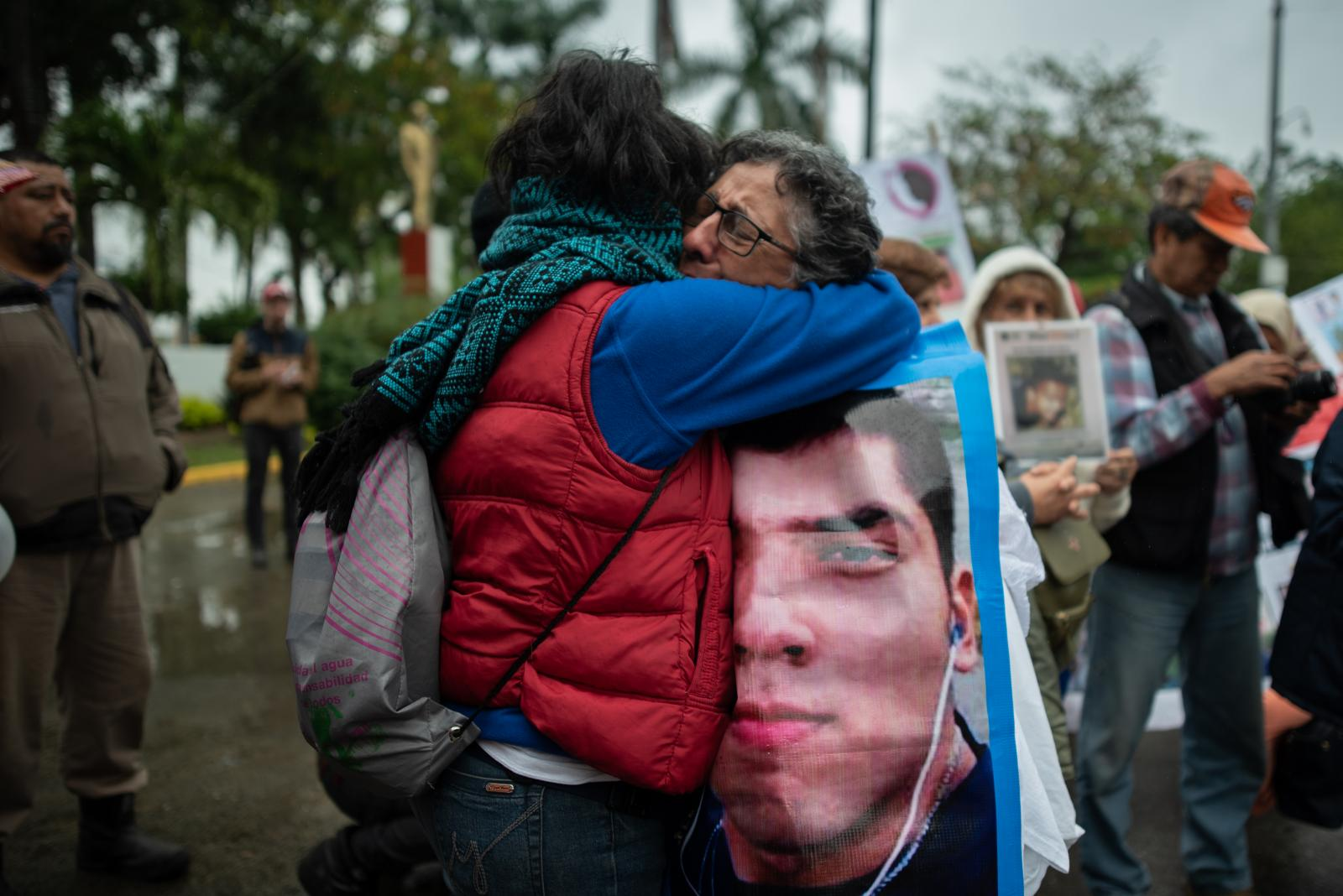 Two women cries during a demonstration of missing persons. Approximately 300 people participated in the fifth National Missing Persons Search Brigade in Poza Rica, Veracruz, Mexico, on February 21, 2020. Victoria Razo for NPR