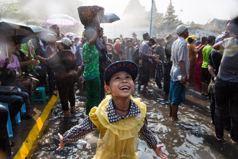Young girl celebrates Thinygan water festival in Yangon, Myanmar.
