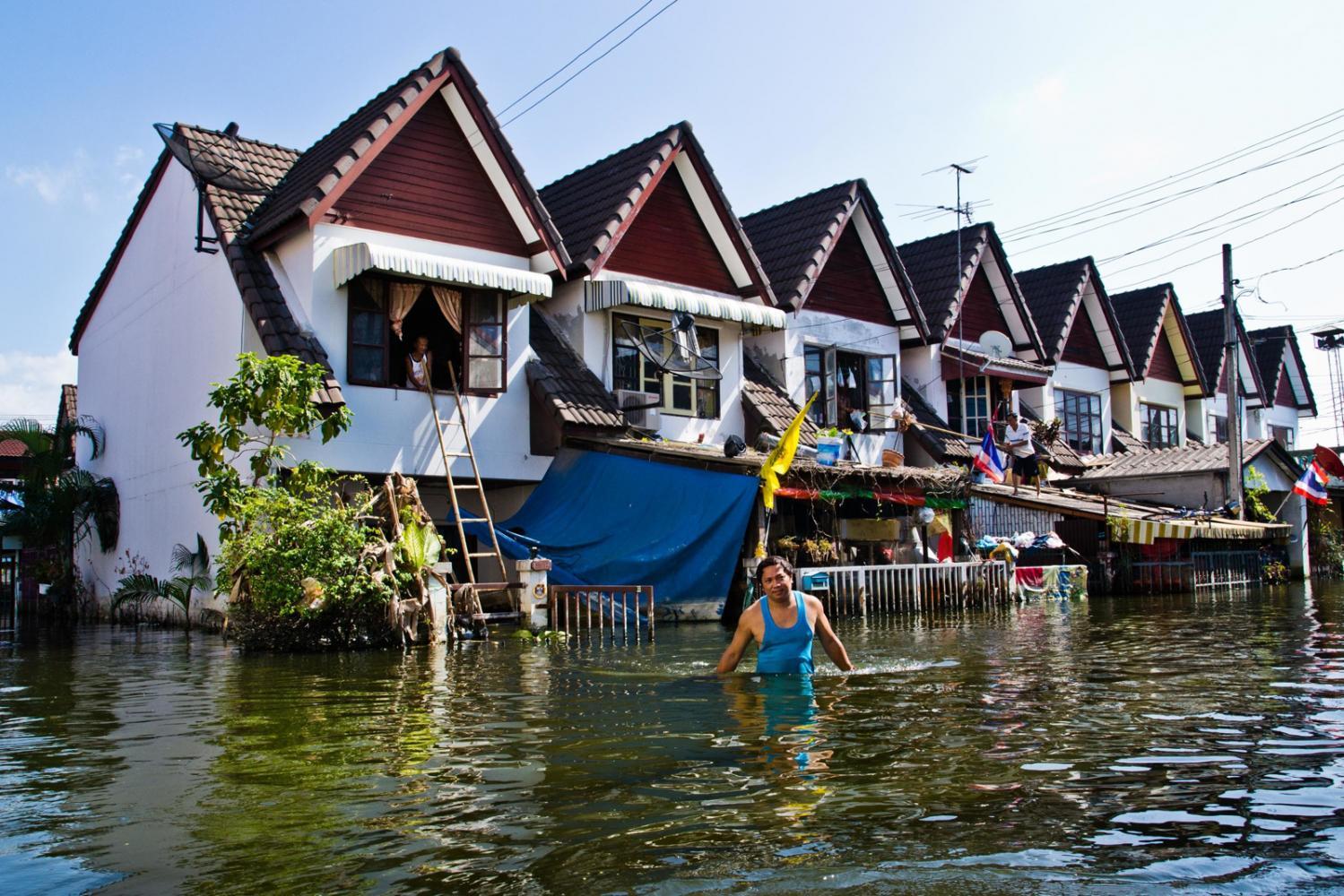 A man wades his Bangkok neighborhood during the 2011 floods.