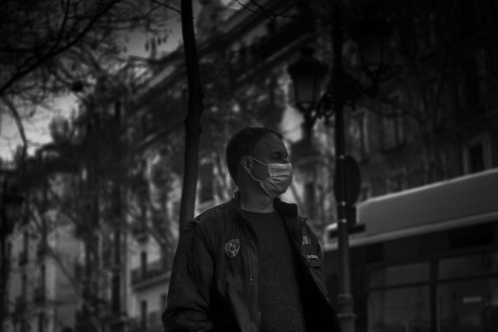 A man wearing a protective mask is seen in Madrid empty streets during the coronavirus lockdown.