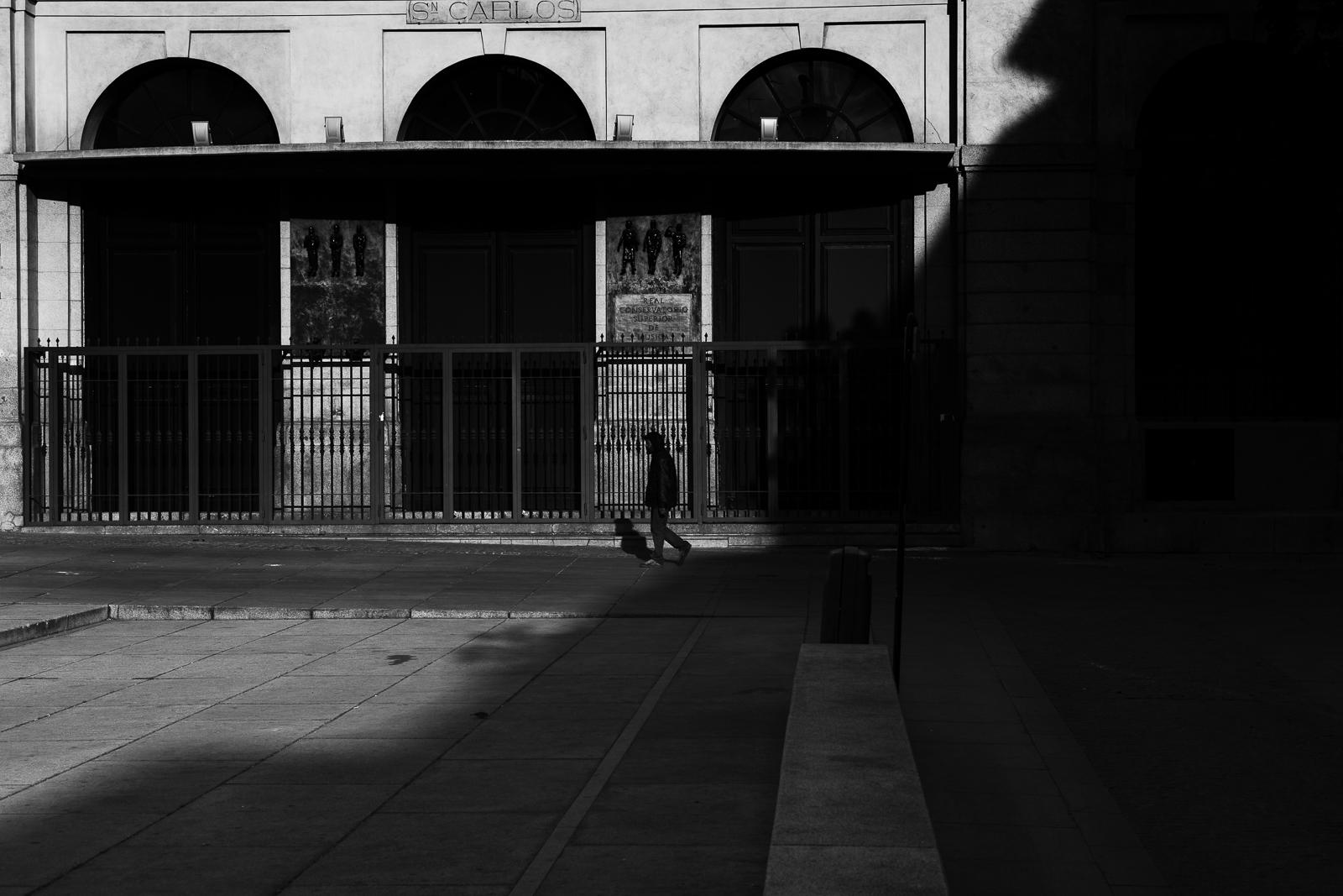 A man walking in the empty streets of Madrid during the coronavirus lockdown.