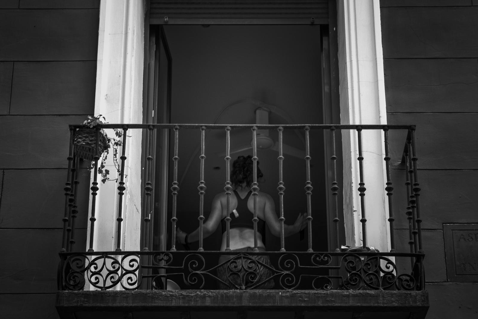 A woman doing exercises in her apartment during the coronavirus lockdown in Madrid Spain.