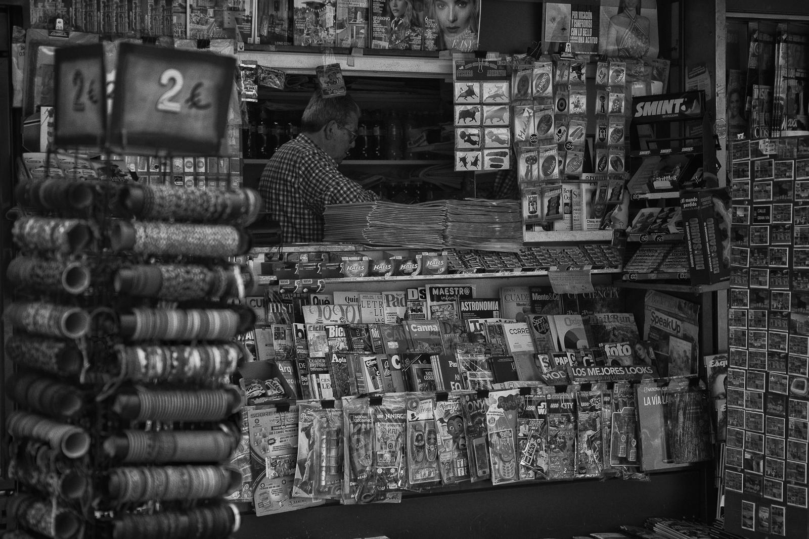 Newspaper stand is one of the few places that are allowed to be open during the coronavirus lockdown in the city center of Madrid.
