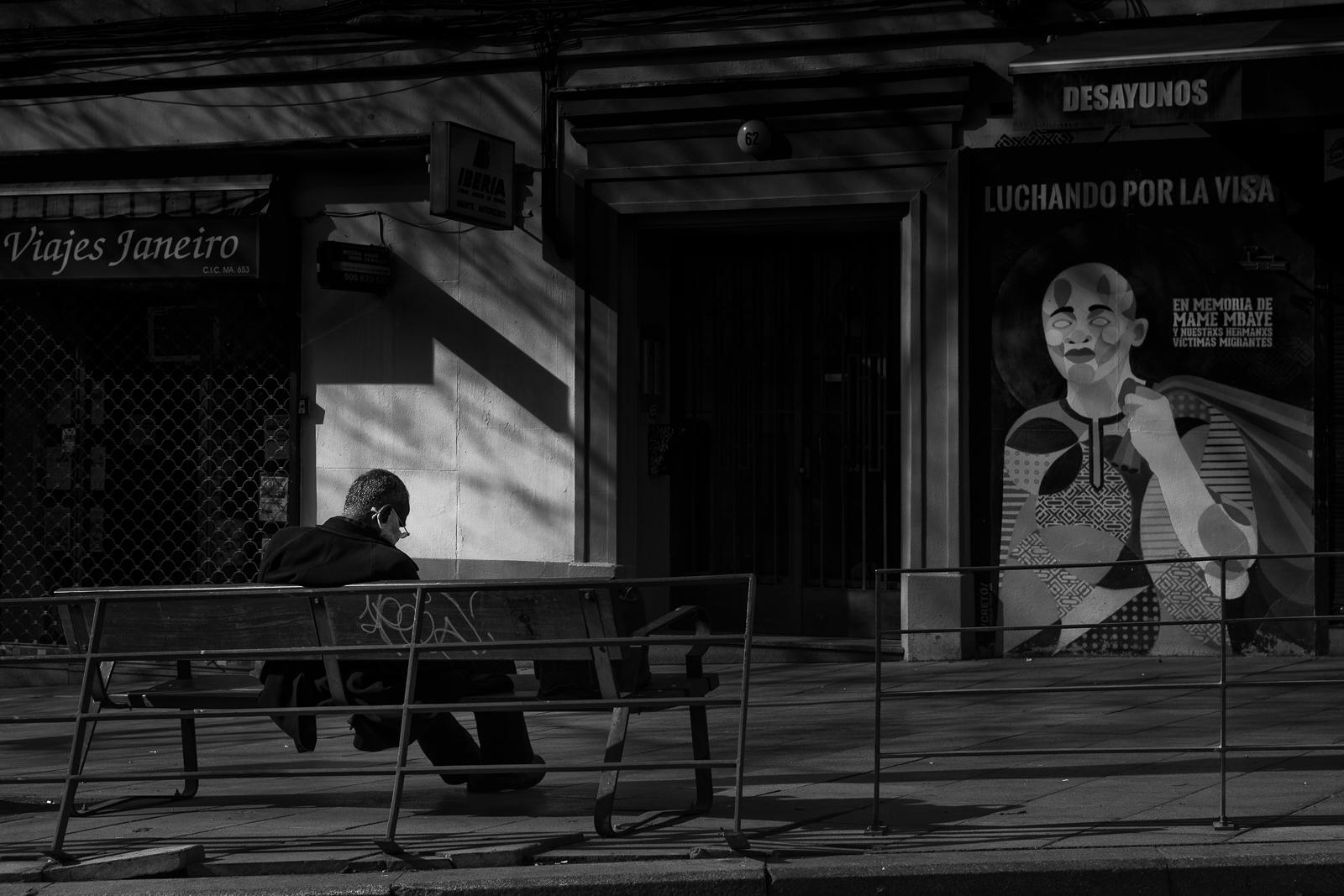 A man siiting in a bench in the empty sterets of Madrid, Spain during the coronavirus lockdown.