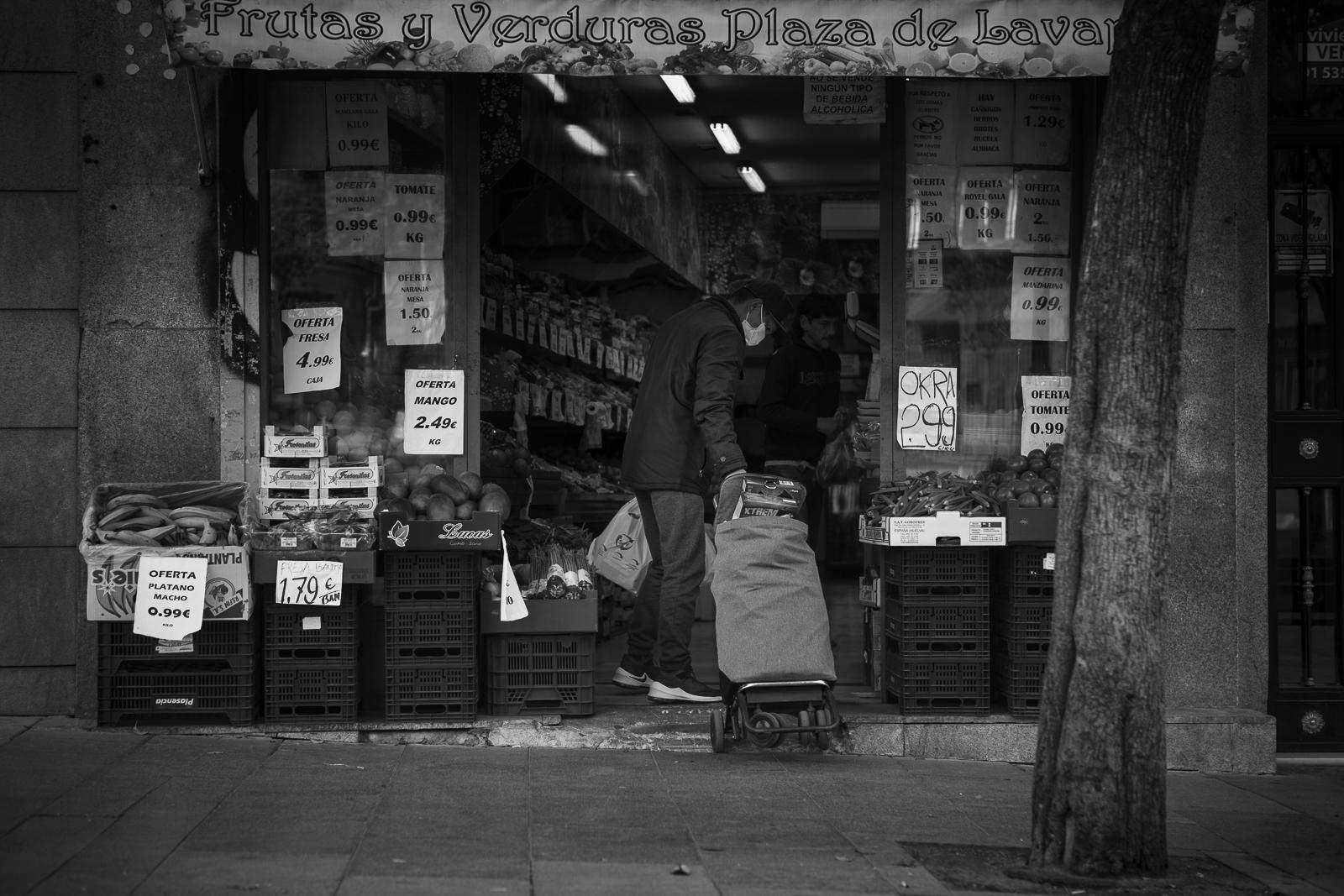A man buying vegetables in a small shop in the Lavapies quarter in Madrid ,Spain, during the coronavirus lockdown.