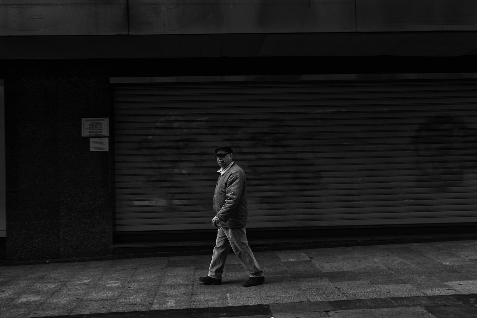 A elderly man walking in Preciados Street in Madrid city center during the coronavirus lockdown.