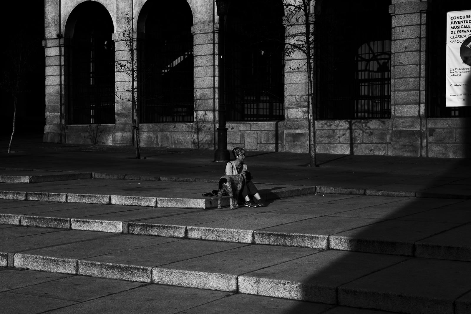 A woman with her dog is seen in a Plaza near the Reina Sofia Museum during the lockdown in the Spanish capital of Madrid.