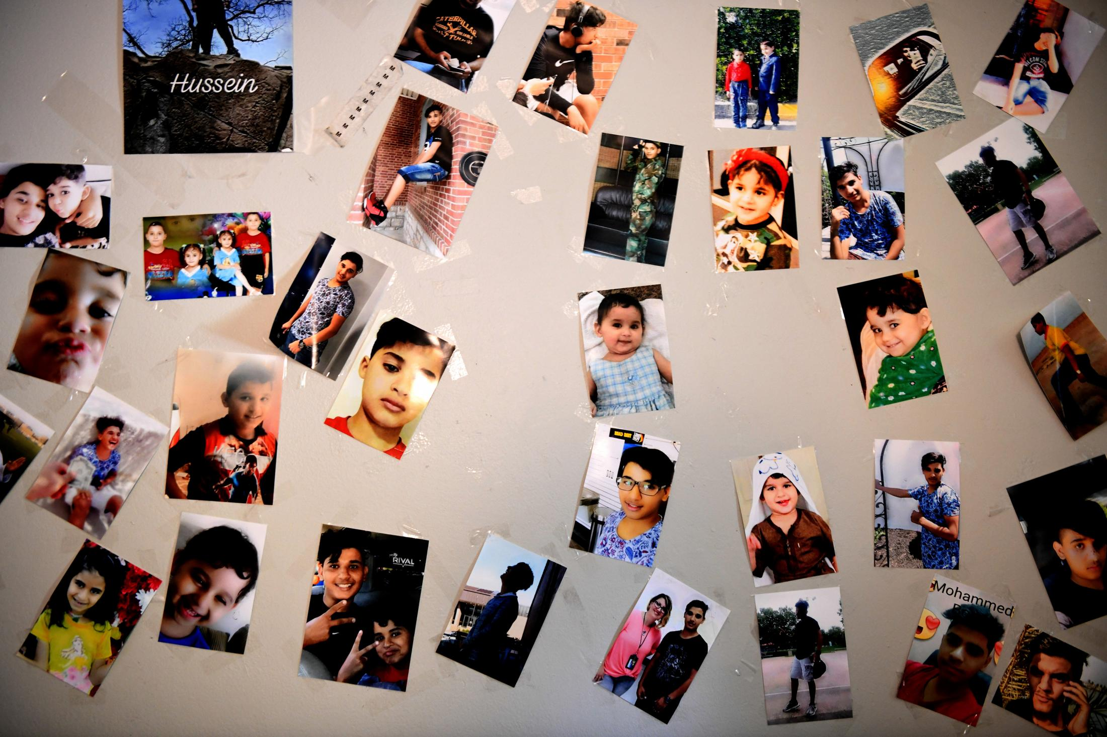Photos of all nine of the Al Hraishawi children are taped to the wall of Hussein's room. The entire family was born in Iraq, but some of the older children were spent their whole childhood there.