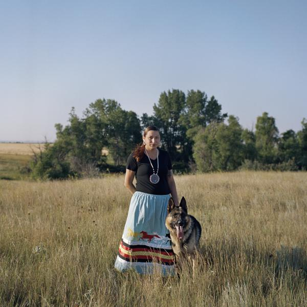 """Heather Belgrade, 23, with her dog, Vador, near her home in Fort Kipp, on Fort Peck Indian Reservation. Heather lost her best friend, Savannah Greywind to a brutal murder, and her cousin, Olivia Lonebear, was found dead on Fort Berthold Reservation. """"I hope one day we can get [them] justice…[they] didn't deserve to die like that...it should have been more peaceful."""""""